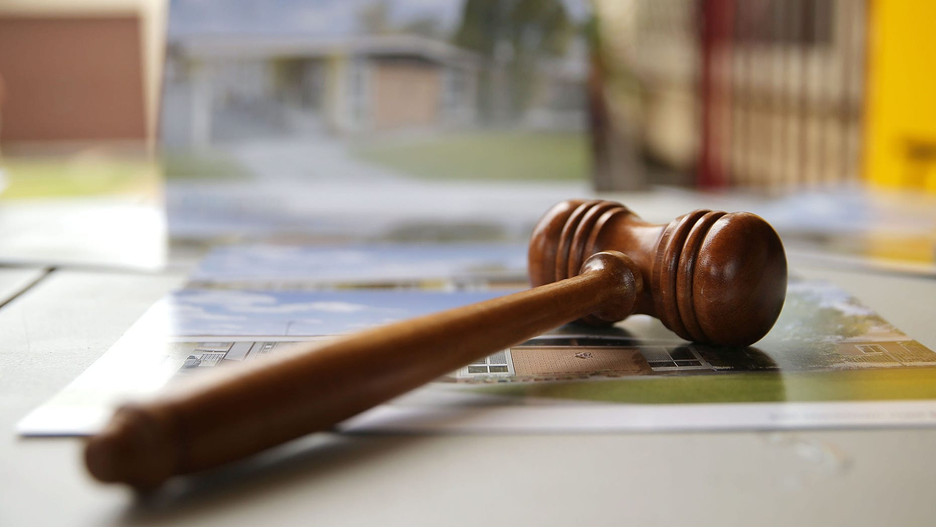 BLACKTOWN, AUSTRALIA - FEBRUARY 14:  An auctioneer's gavel is seen prior to the home auction for a four-bedroom house at 230 Blacktown Road on February 14, 2015 in Blacktown, Australia. The Blacktown home sold for AUD$565,000 at auction today, smashing the reserve set at AUD$1. The Sydney home auction clearance rate is expected to remain high following the Reserve Bank's interest rate cut to 2.25 per cent last week.  (Photo by Mark Metcalfe/Getty Images)