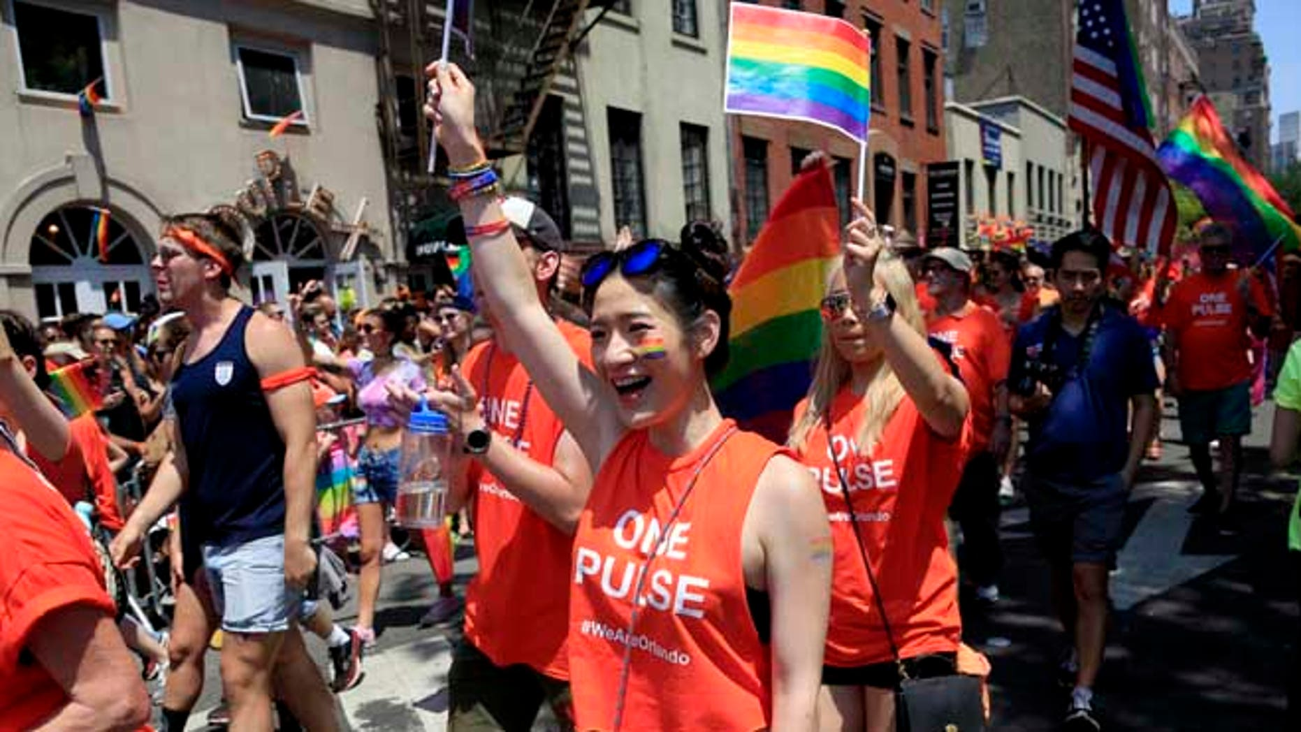 Participants in the NYC Pride Parade wear shirts in support of the victims of the Orlando massacre in New York, Sunday, June 26, 2016. A year after New York City's jubilant pride parade celebrated a high point for gay Americans with the nationwide legalization of same-sex marriage, the atmosphere surrounding the annual march couldn't be more different. Sunday's parades in New York, San Francisco and other cities are unfolding two weeks after a gay nightclub in Florida became the site of the nation's deadliest mass shooting by a single gunman in modern U.S. history. (AP Photo/Seth Wenig)
