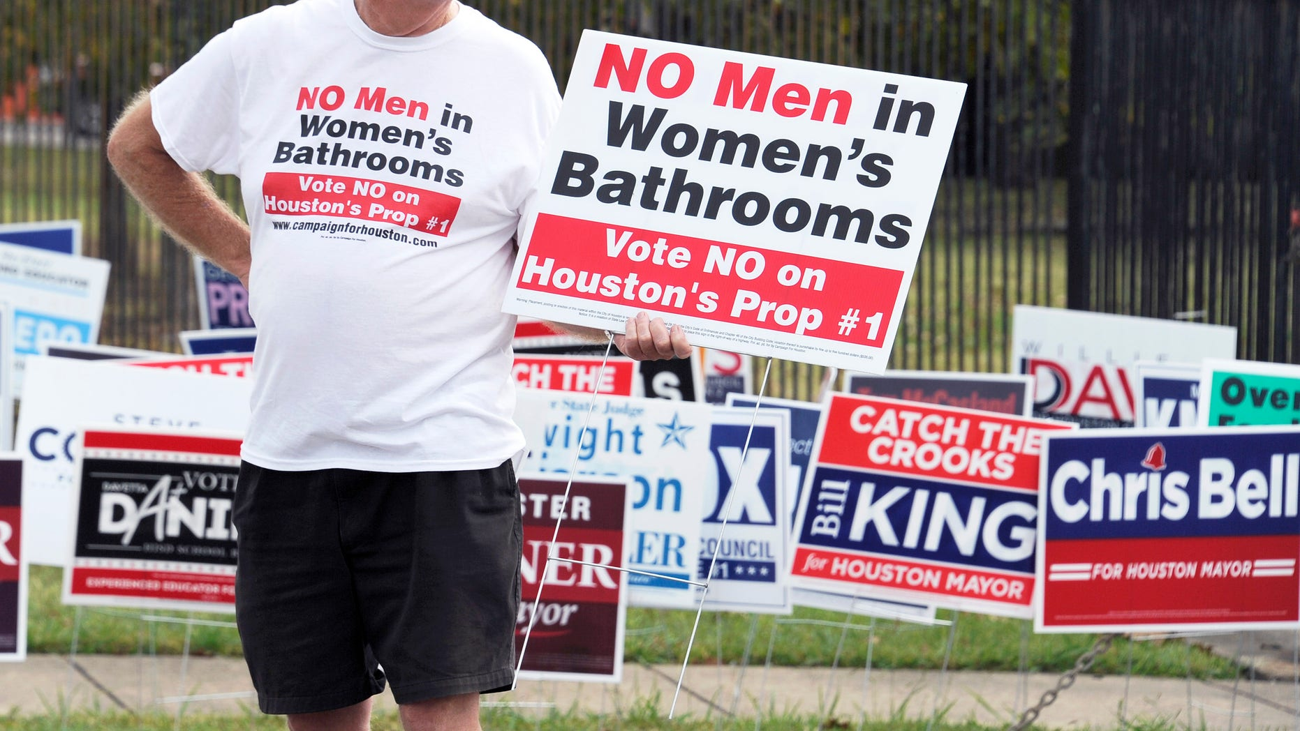 FILE -- Oct. 21, 2015: A man urges people to vote against the Houston Equal Rights Ordinance outside an early voting center in Houston. (AP Photo/Pat Sullivan)