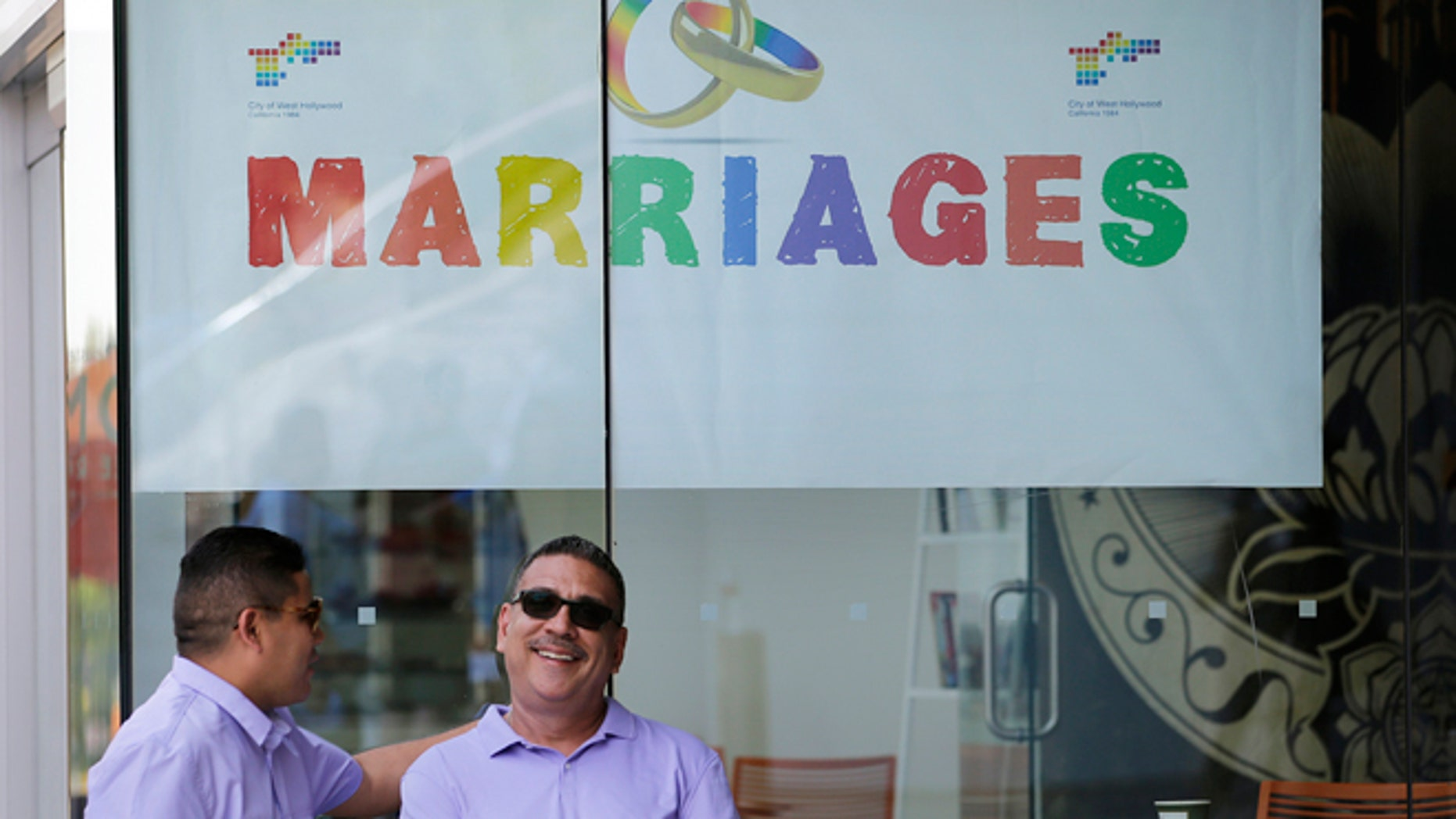 FILE: July 1, 2013: A same-sex couple before their wedding ceremony in West Hollywood, Calif.
