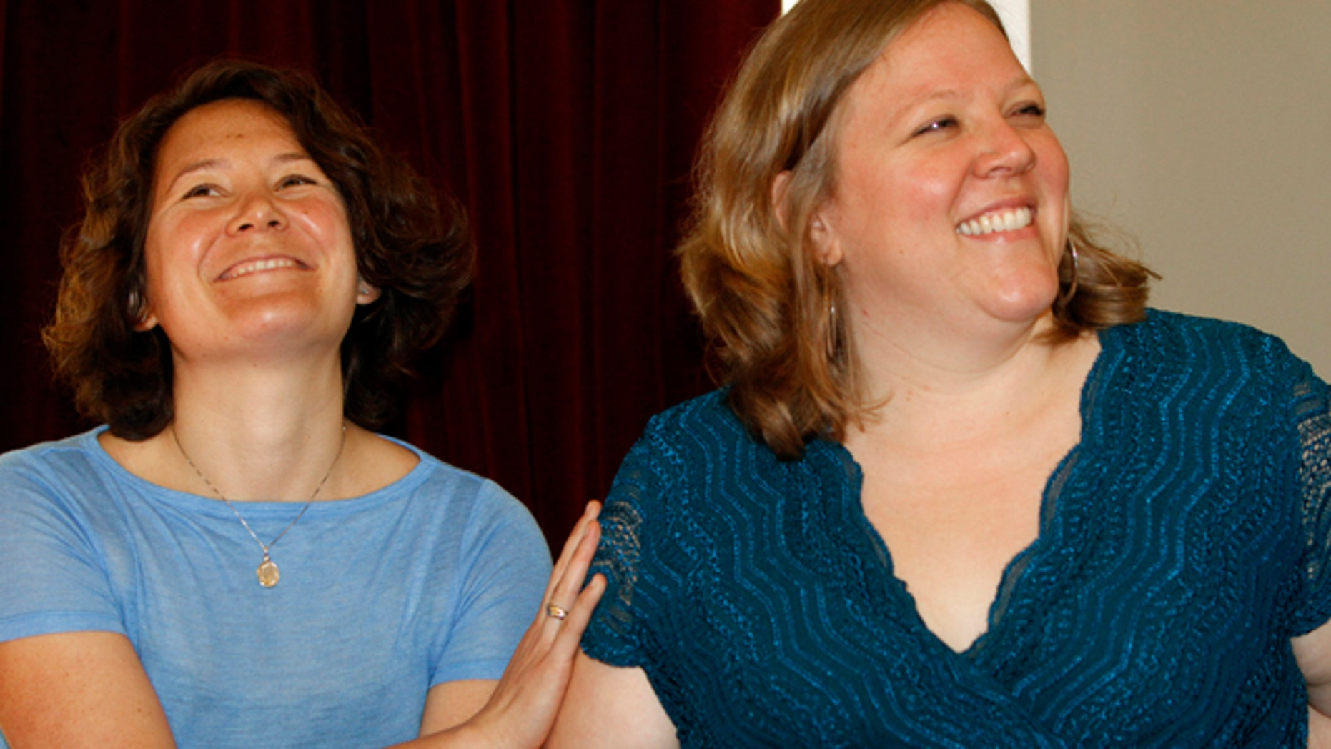 July 19: Ming Linsley, left, and Kate Baker smile during a news conference in Montpelier, Vt. The owners of a Vermont inn that refused to host the lesbian couple's wedding reception say they have no policy to discriminate against same-sex couples.