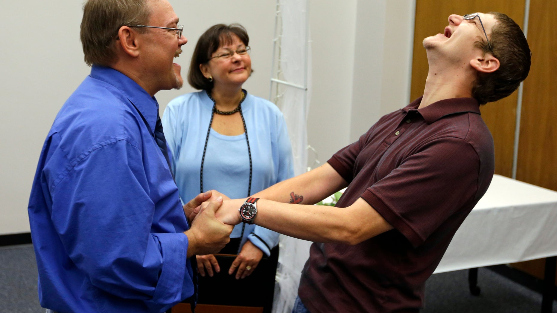 June 26, 2014: Adam Shoffner, right, shouts his joy after he married Daniel Tolliver, left, as Marion County Clerk Beth White looks on as same sex couple continued to be married for the second day in Indianapolis.