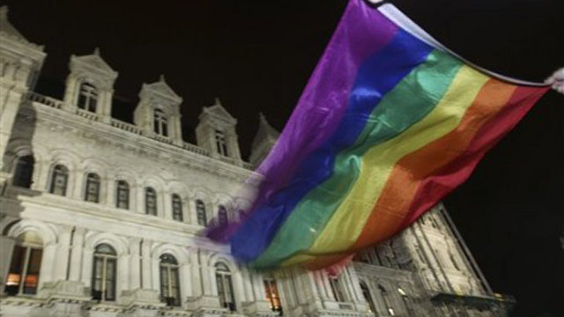 June 24, 2011: A pride flag waves outside the Capitol in Albany, N.Y., after the state Senate passed a bill legalizing same-sex marriage.