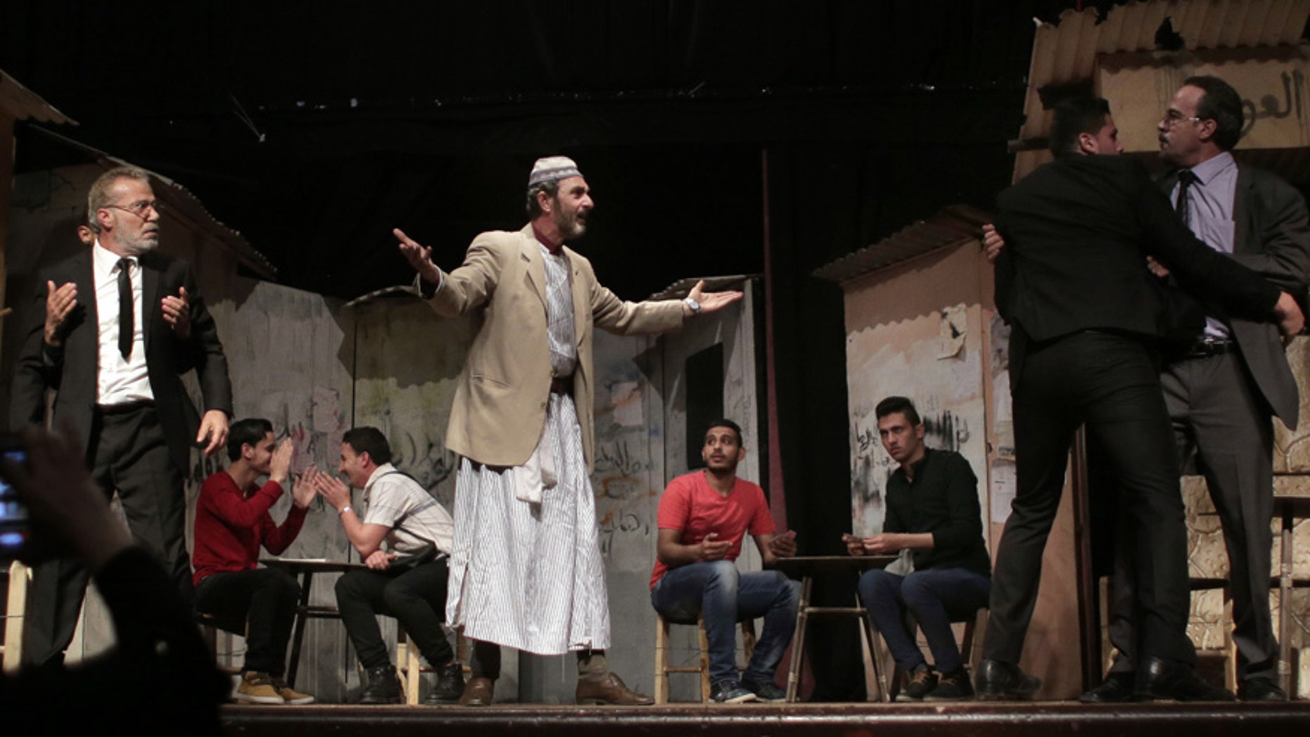 """April 28, 2016: Palestinian actors perform a Gaza version of Shakespeare's """"Romeo and Juliet"""" play on the stage of a cultural center in Gaza City."""