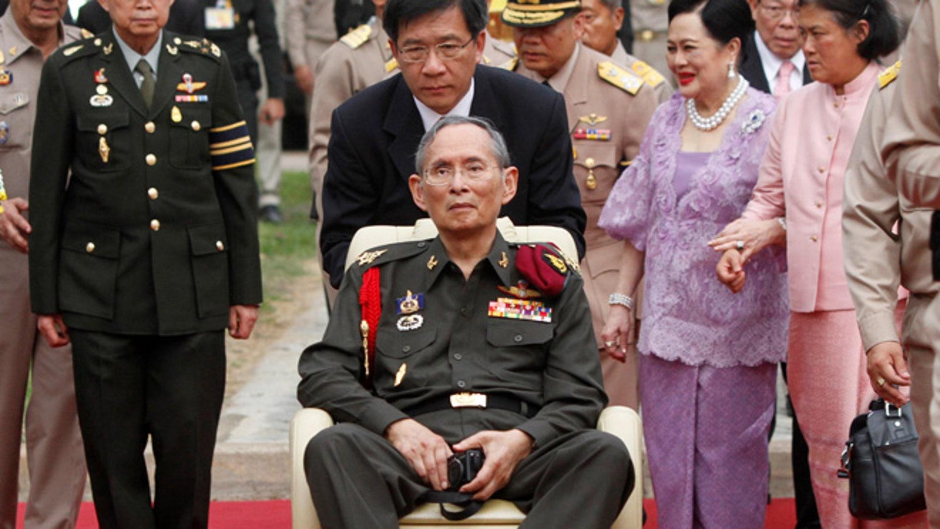 Thailand's King Bhumibol Adulyadej, center, visits Thung Makham in Ayutthaya province, north of Bangkok.