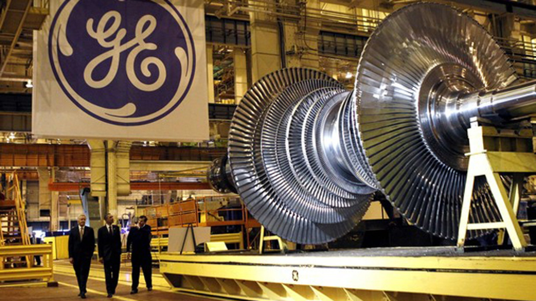 President Obama, center, passes a turbine as he tours General Electric's birthplace in Schenectady, N.Y., Jan. 21. Flanking Obama are GE CEO Jeffrey Immelt, left, and plant manager Kevin Sharkey.