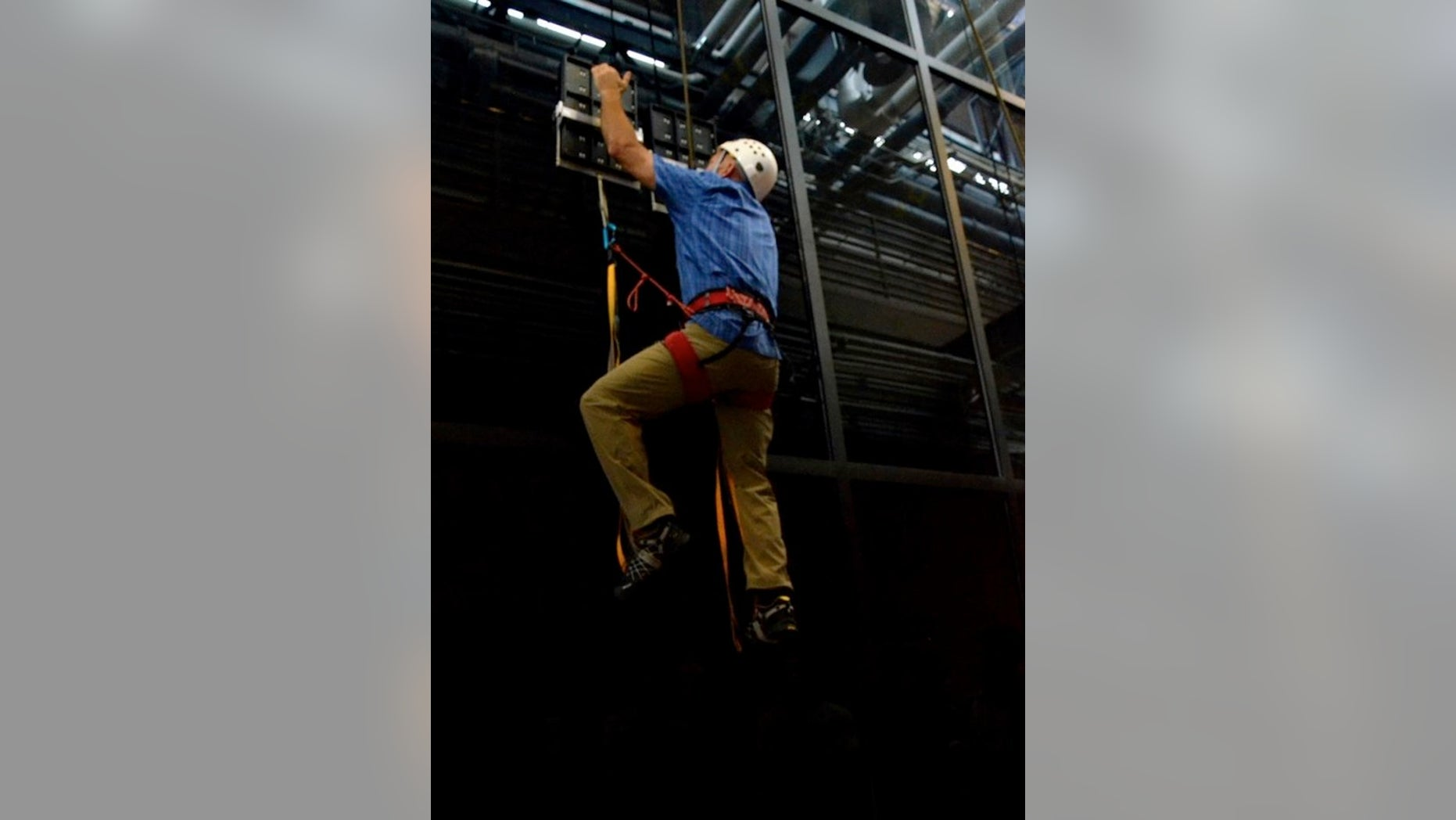 During testing, an operator climbed 25 feet vertically on a glass surface using no climbing equipment other than a pair of hand-held, gecko-inspired paddles. The climber wore, but did not require, the use of a safety belay.