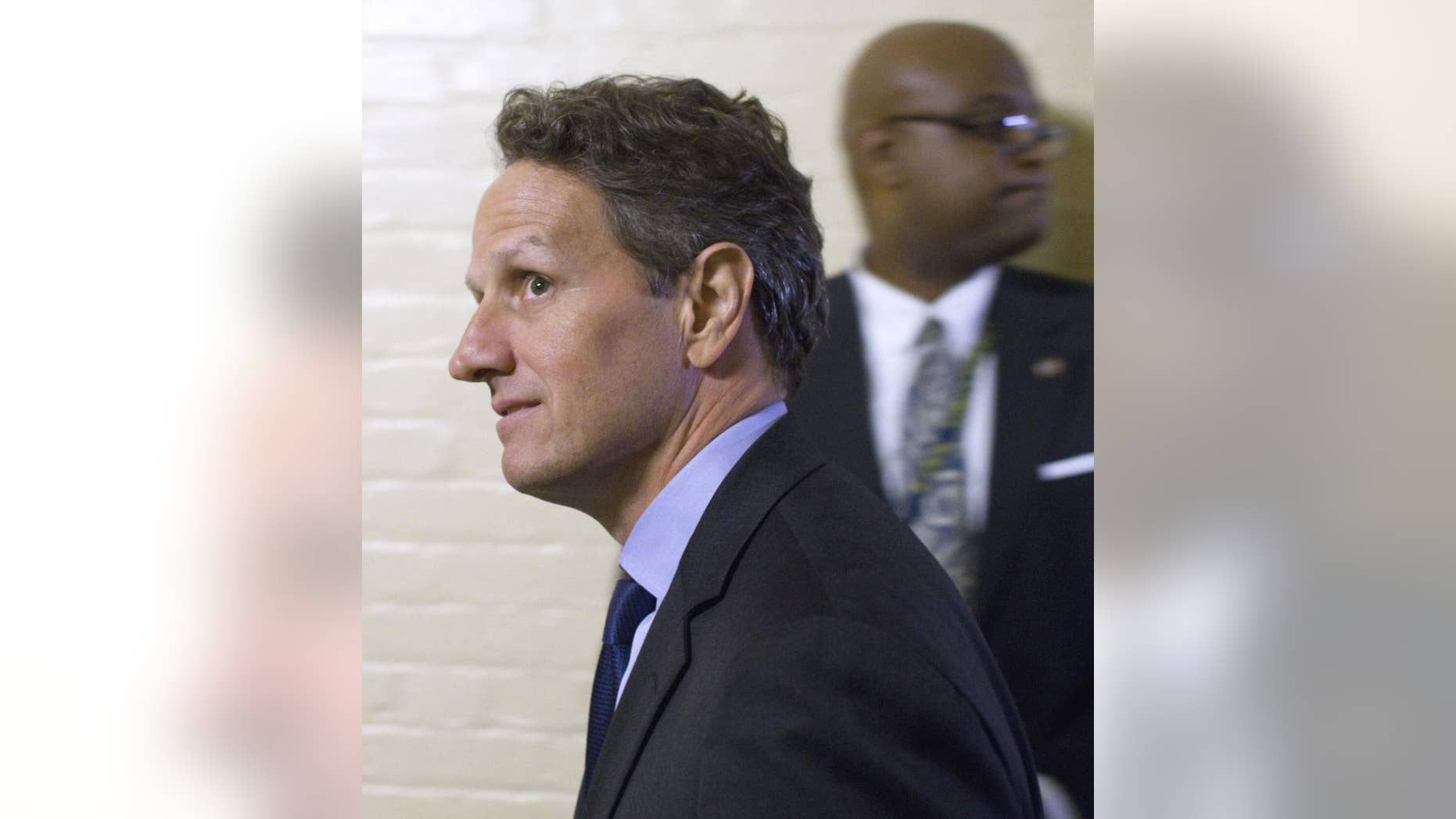 Treasury Secretary Timothy Geithner arrives for a House GOP freshman caucus meeting on Capitol Hill in Washington, Thursday, June 2, 2011. (AP Photo/Harry Hamburg)