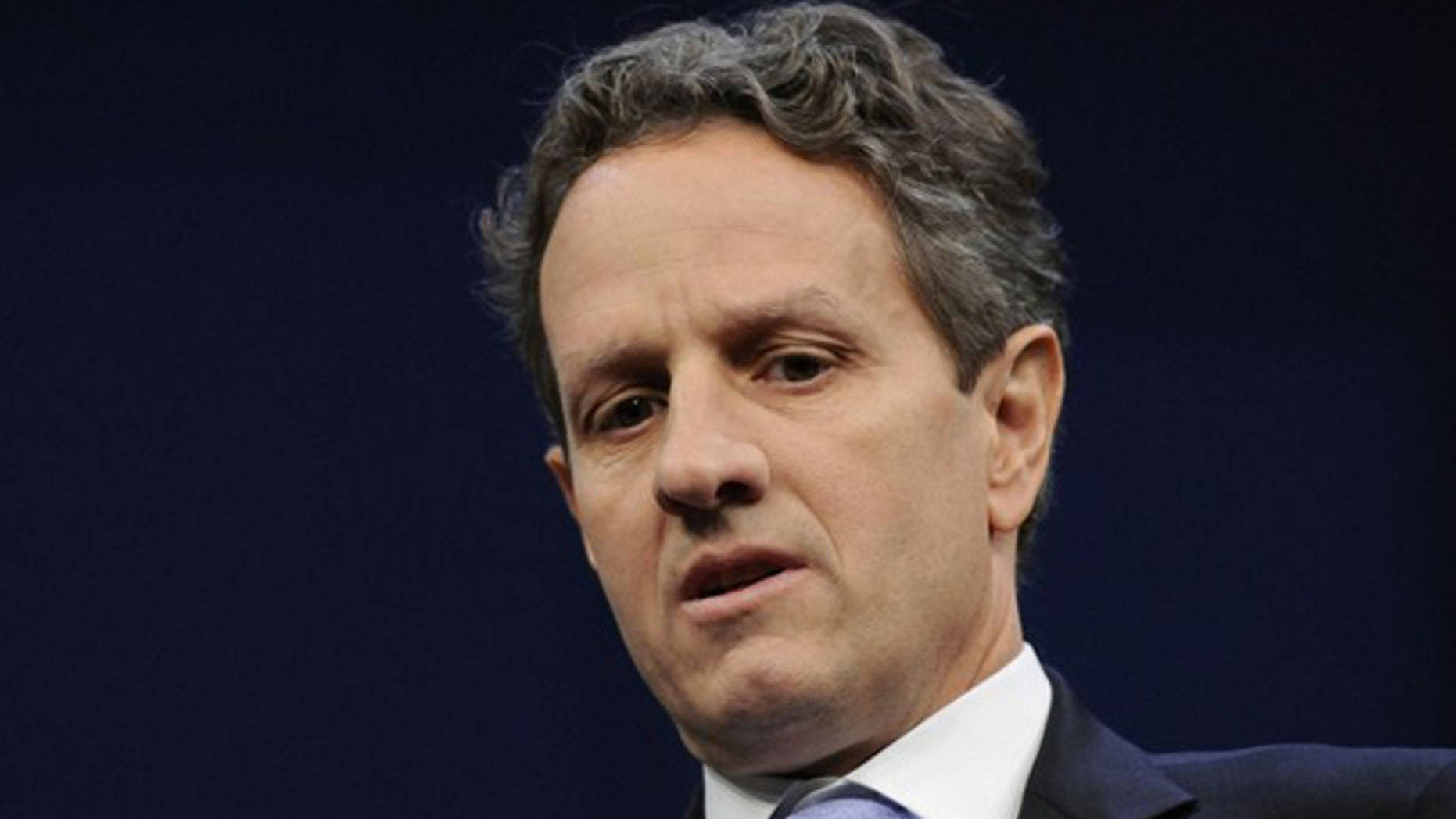 Treasury Secretary Timothy Geithner sits onstage for an interview at the Newseum in Washington May 25.