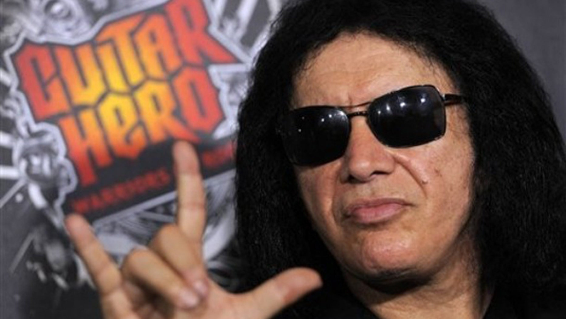 "Gene Simmons of the rock band Kiss arrives at the launch of the video game, ""Guitar Hero: Warriors of Rock,"" in Los Angeles, Monday, Sept. 27, 2010. (AP Photo/Chris Pizzello)"