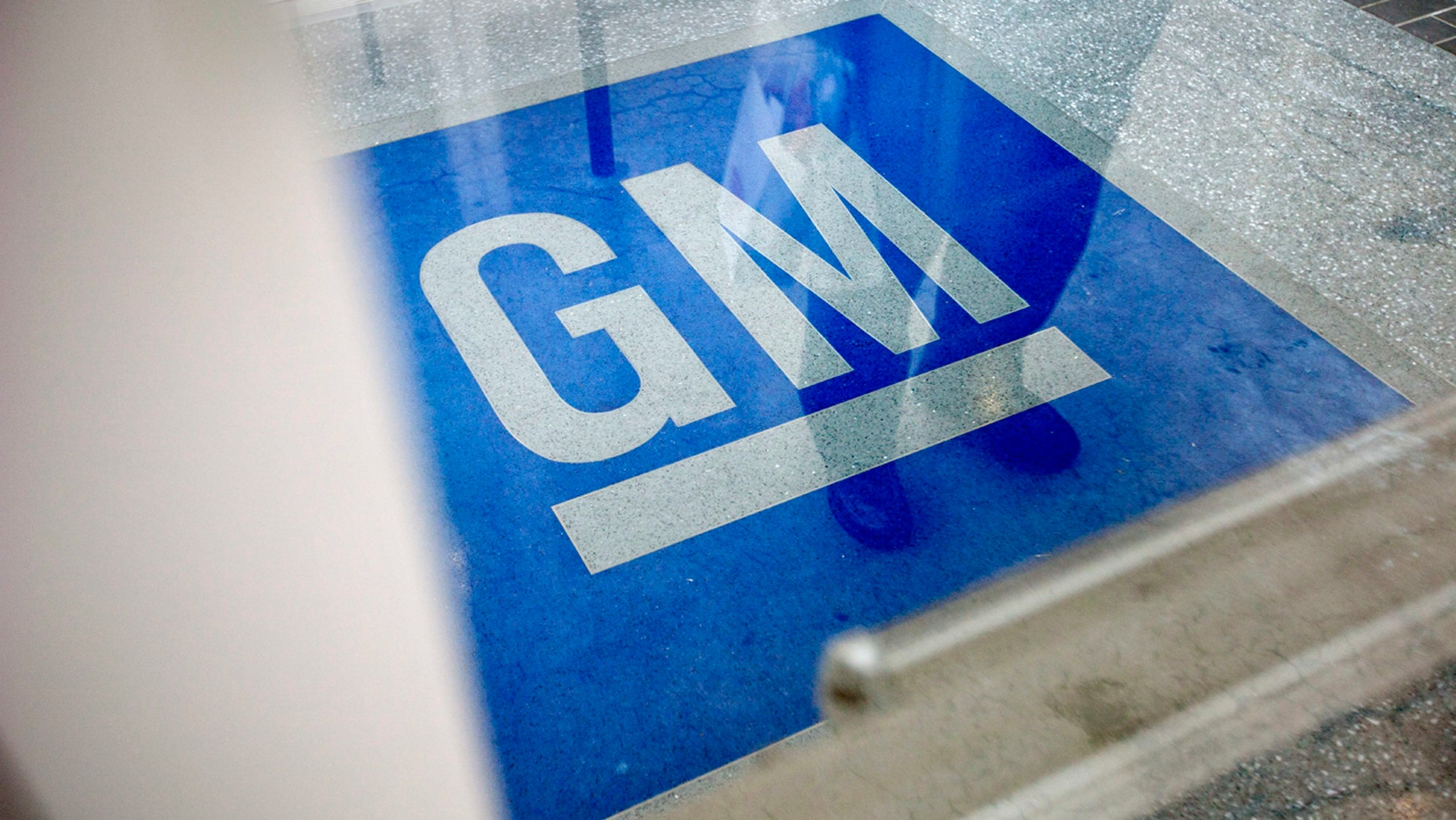 Jan. 10, 2013:  The logo for General Motors decorates the entrance at the site of a GM information technology center in Roswell, Ga.
