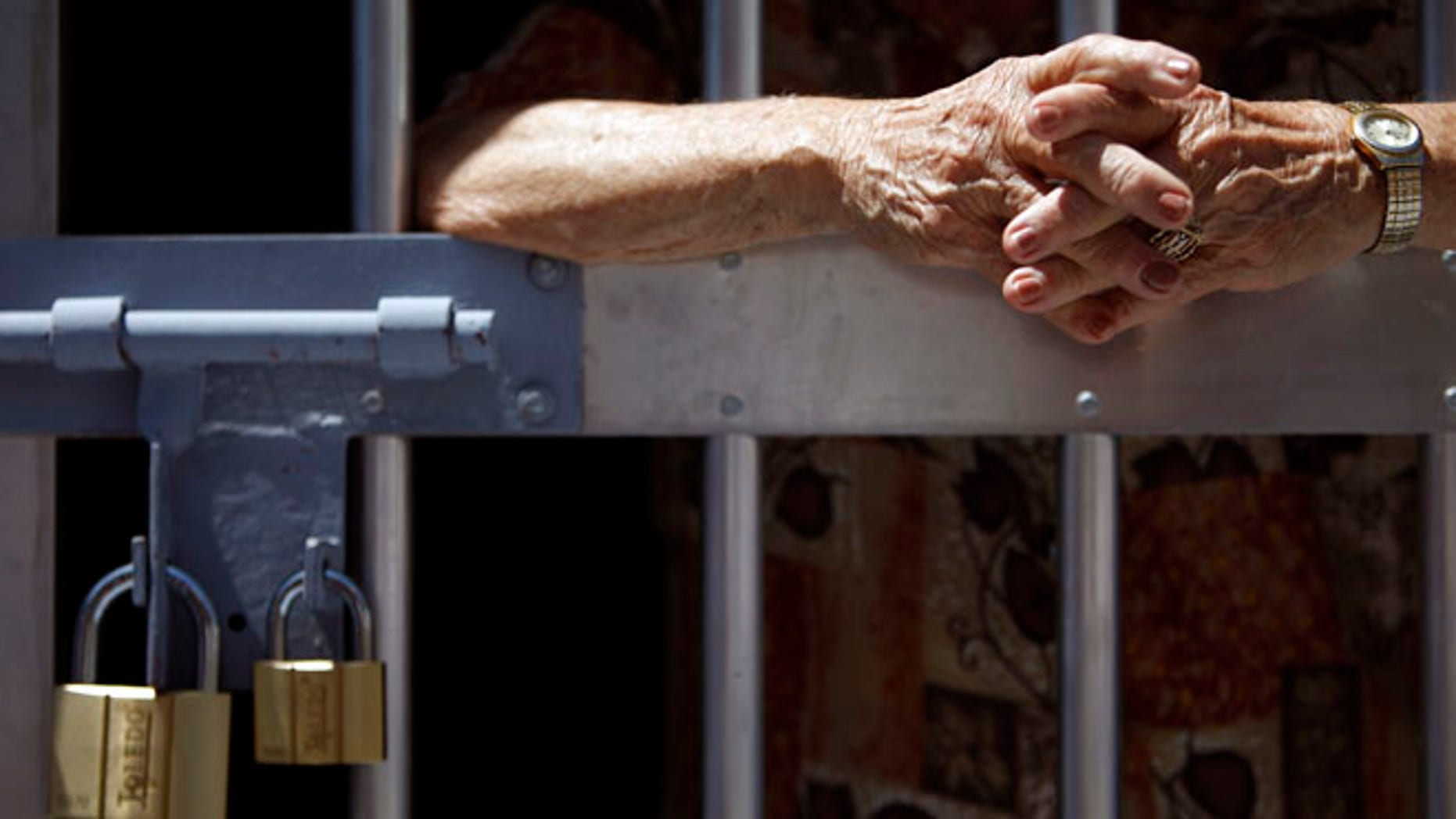 May 29, 2013: Unidentified man stands behind prison bars.