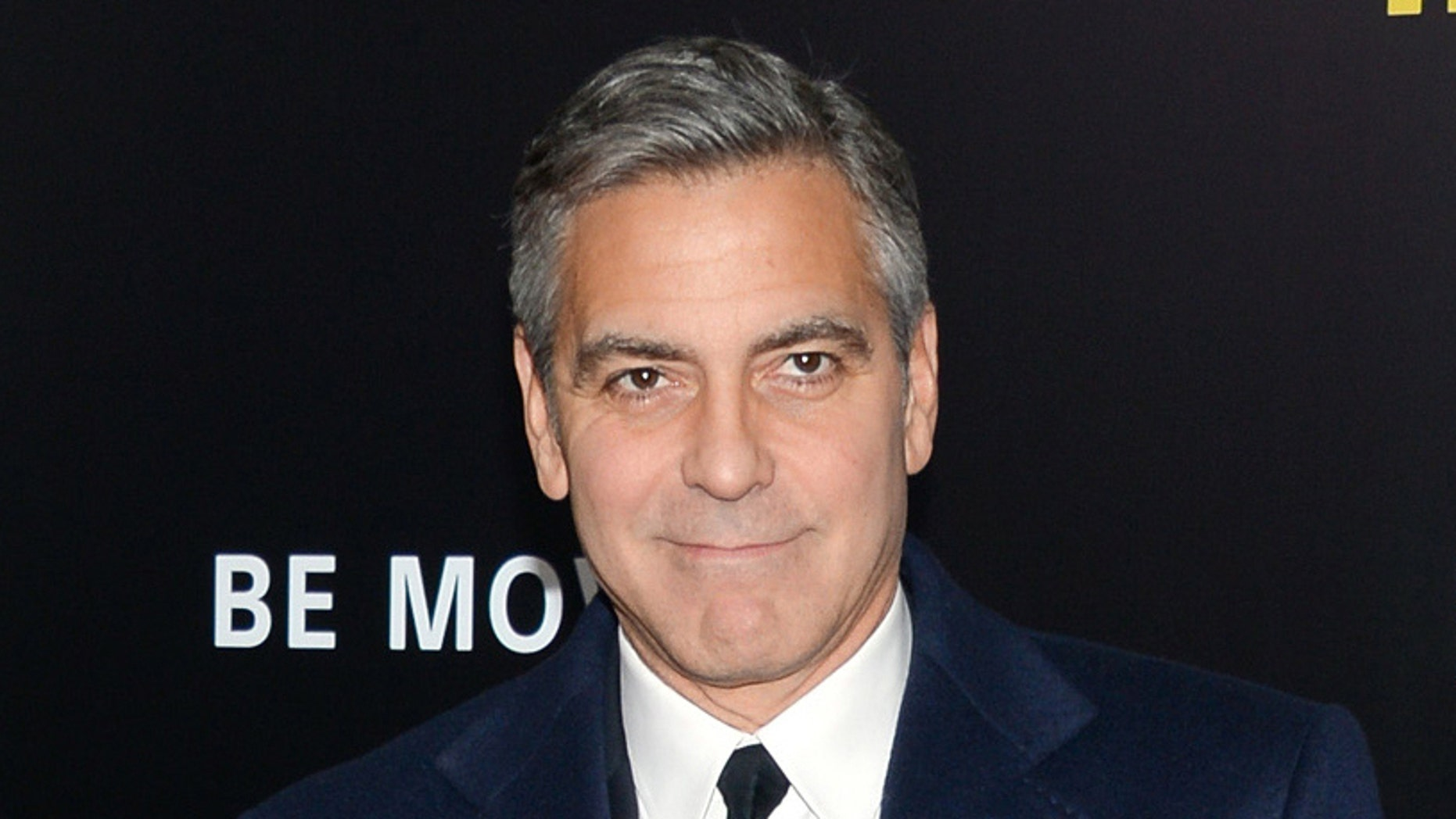 "Feb. 4, 2014. George Clooney attends the premiere of ""The Monuments Men"" at the Ziegfeld Theatre in New York."