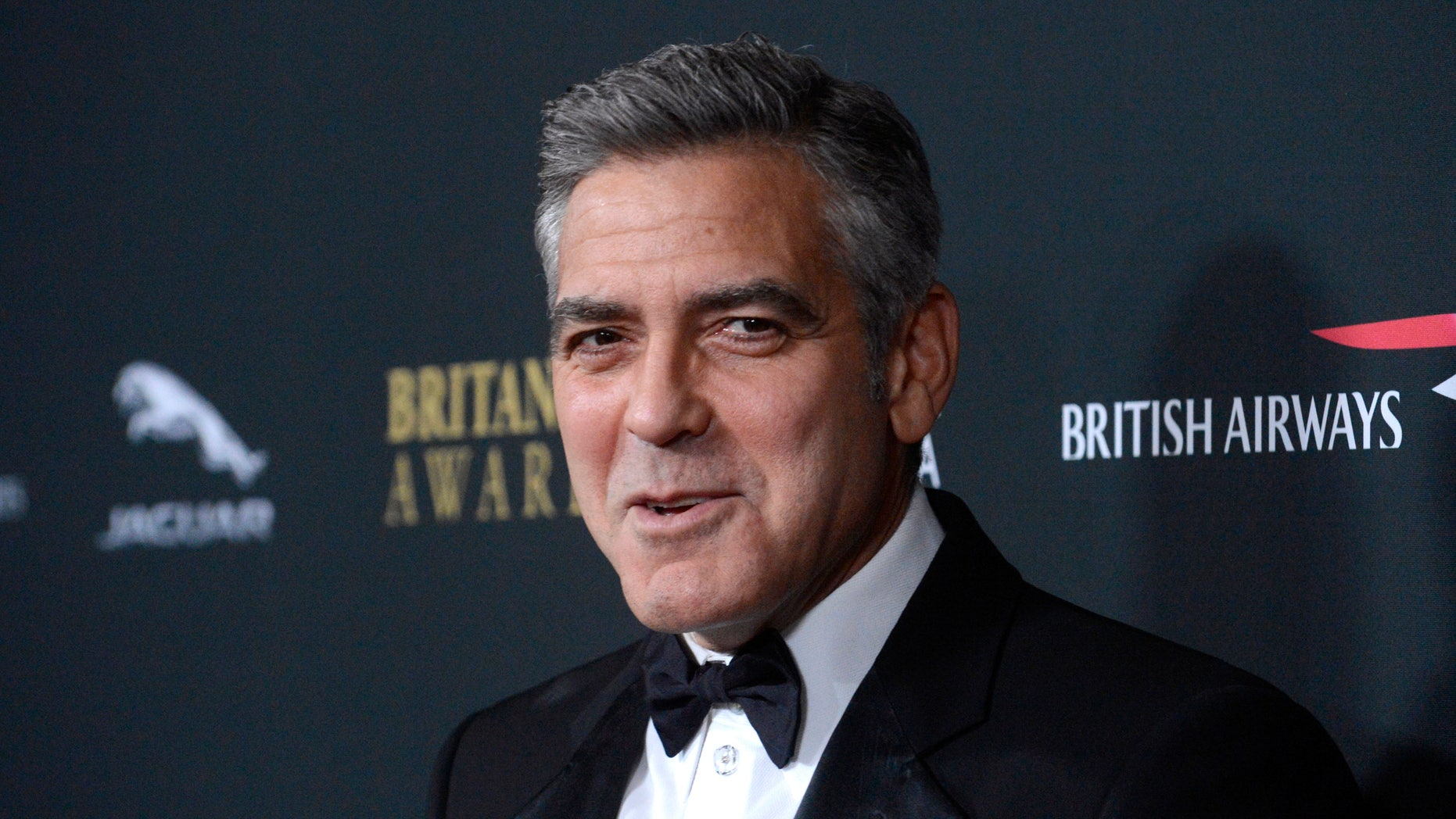 Actor George Clooney attends the BAFTA Los Angeles Britannia Awards in Beverly Hills, California  November 9, 2013. REUTERS/Phil McCarten (UNITED STATES - Tags: ENTERTAINMENT) - RTX157GT