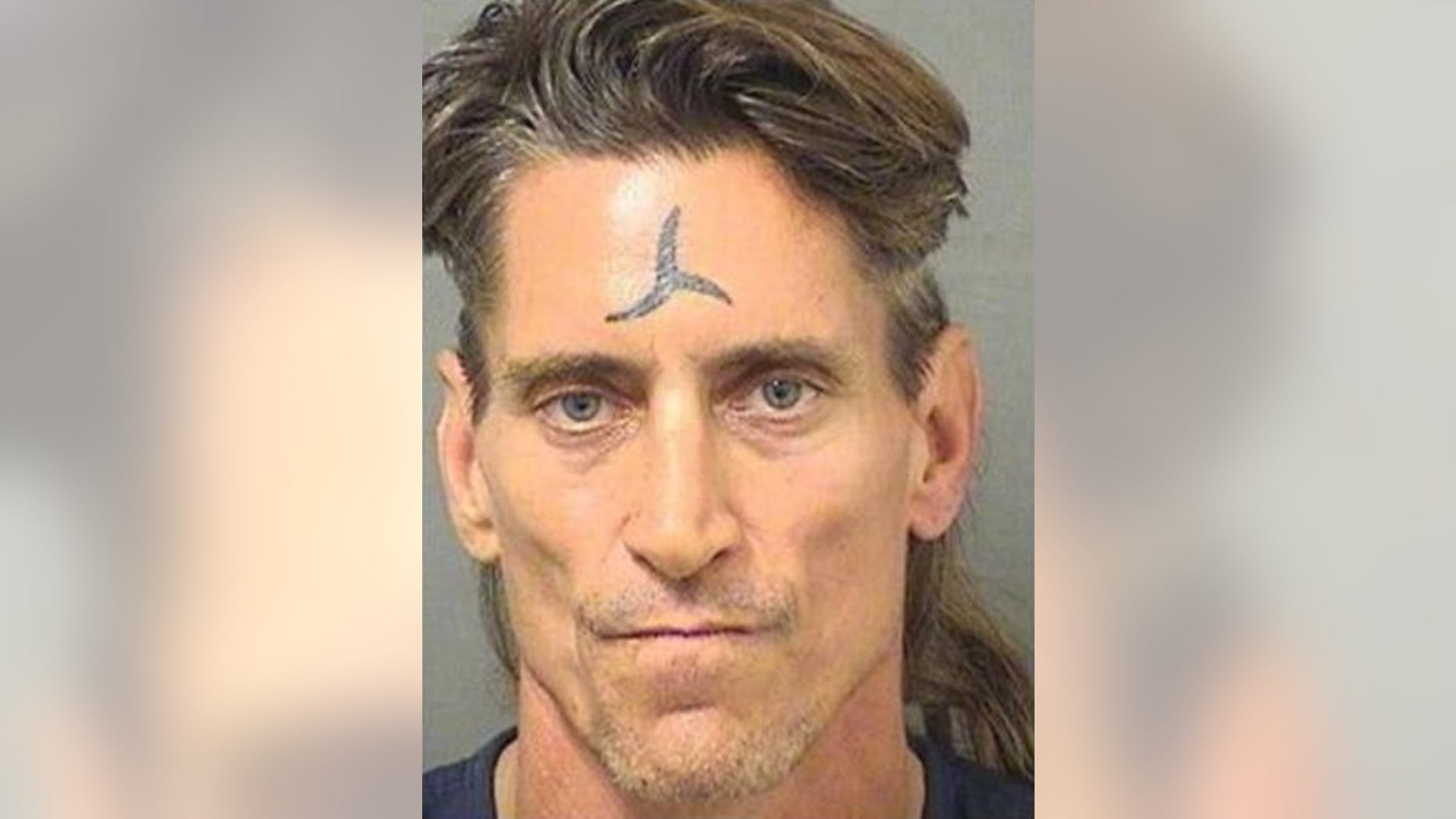 George C. Livingston, 51, was charged with second-degree murder after a man he knew was found dead next to a three-foot sword in Florida.