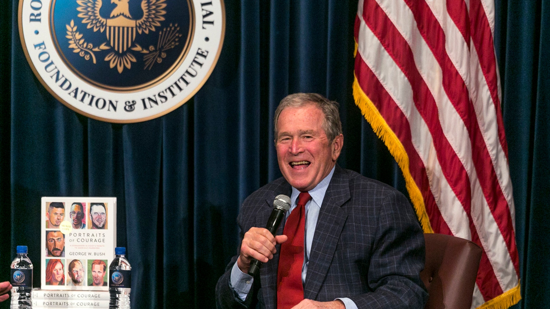 """Former U.S. President George W. Bush discusses his new book """"Portraits of Courage: A Commander in Chief's Tribute to America's Warriors,"""" a collection of his artwork featuring paintings of veterans and stories at the Ronald Reagan Presidential Library in Simi Valley, Calif., Wednesday, March 1, 2017. (AP Photo/Damian Dovarganes)"""