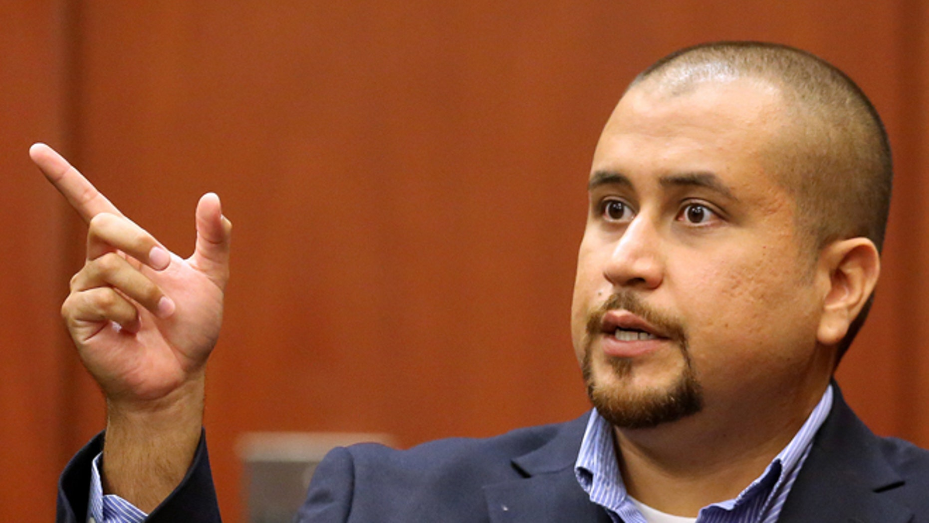 George Zimmerman gestures during his testimony at a hearing for accused shooter Matthew Apperson in September 2015.
