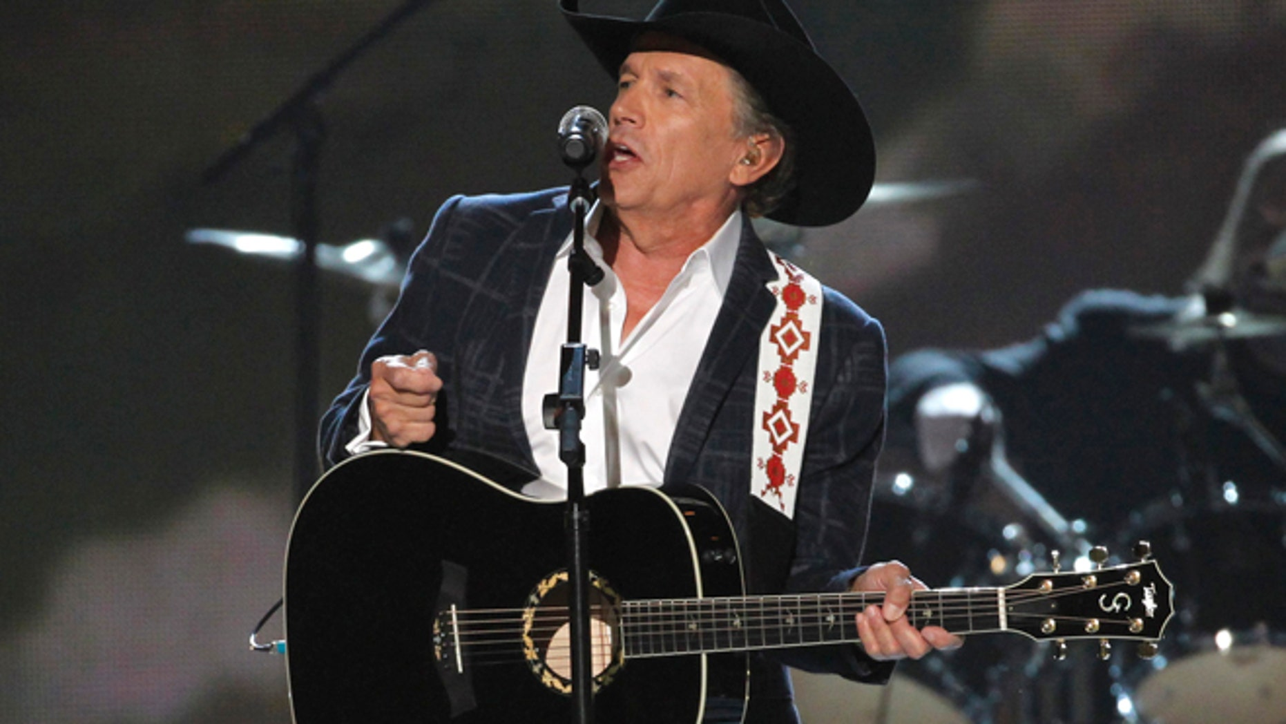 """April 6: George Strait performs """"I Got a Car"""" at the 49th Annual Academy of Country Music Awards in Las Vegas, Nevada."""