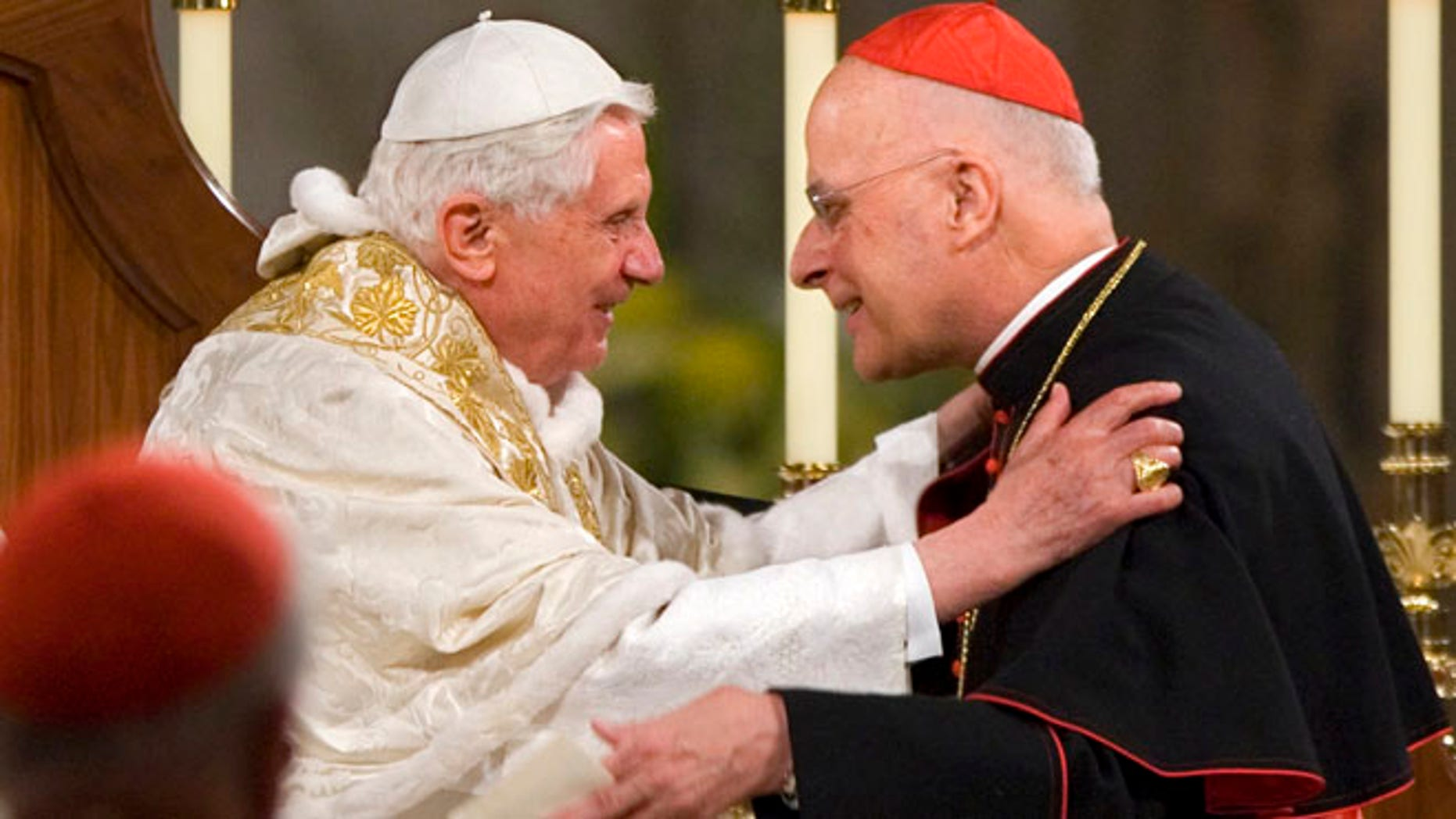 April 16, 2008: Pope Benedict XVI embraces Chicago's Cardinal Francis George after addressing the bishops at the Basilica of the National Shrine of the Immaculate Conception in Washington. (AP)