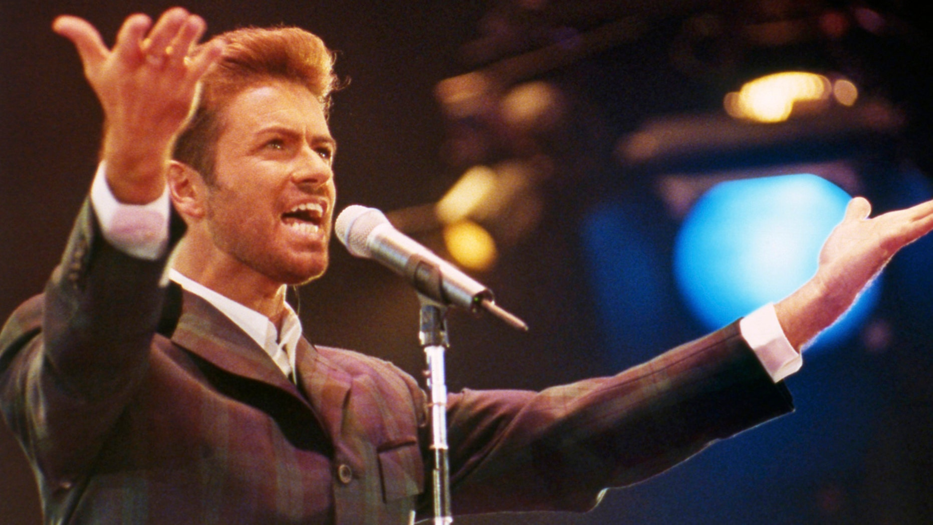 Dec. 2, 1993: George Michael performs at the 'Concert of Hope' to mark World AIDS Day at Wembley Arena in London.
