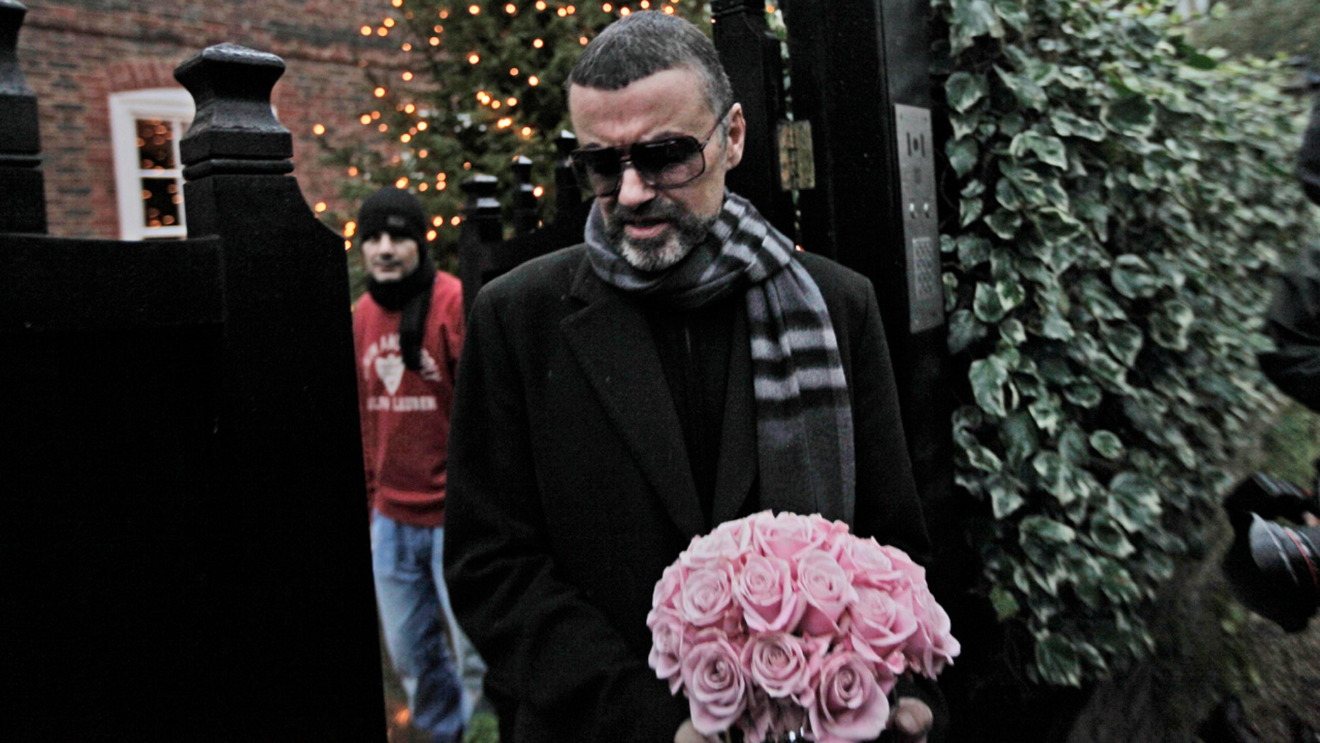 Dec. 23, 2011:  George Michael leaves his house in north London, after recovering from a life-threatening bout with pneumonia that kept him in a Vienna hospital for a month.