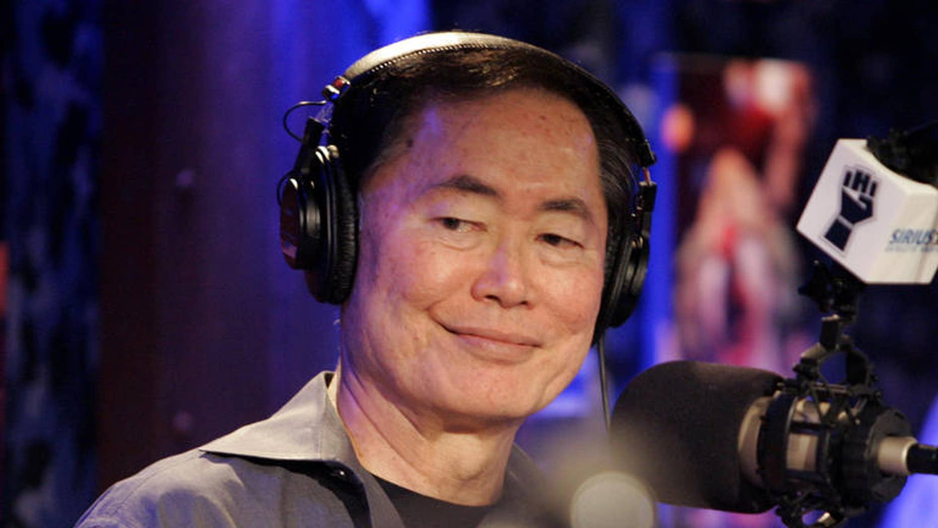 """George Takei, who played Captain Sulu on the popular television show and movie series """"Star Trek"""" and who last year publicly said he is gay, was introduced as Howard Stern's  announcer during his debut show on Sirius Satellite Radio, in New York, Monday Jan. 9, 2006. .Stern's deal could be worth up to $500 million over five years to headline two Sirius channels. (AP Photo/Richard Drew)"""