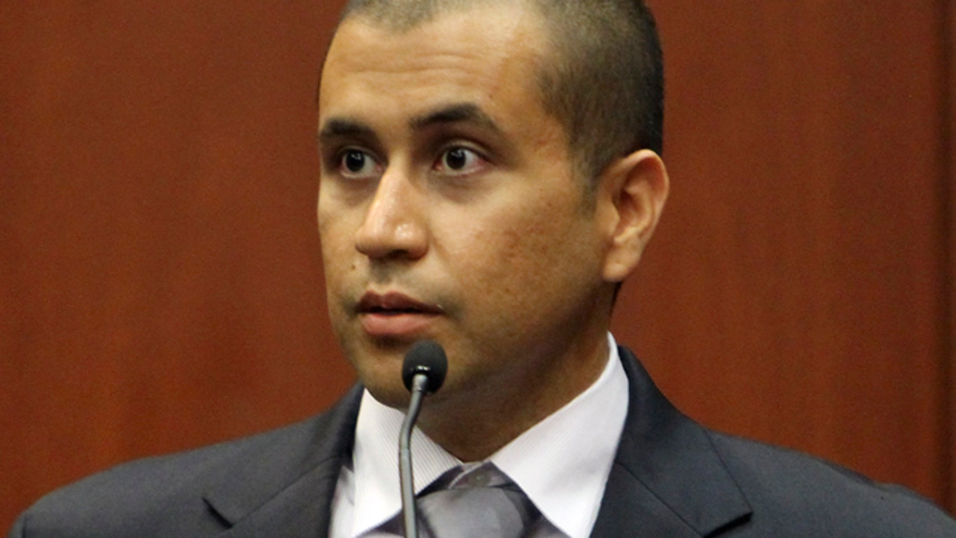 A lawyer for George Zimmerman, above, says some of the money raised by a defense fund website is paying for Zimmerman's security and living expenses.