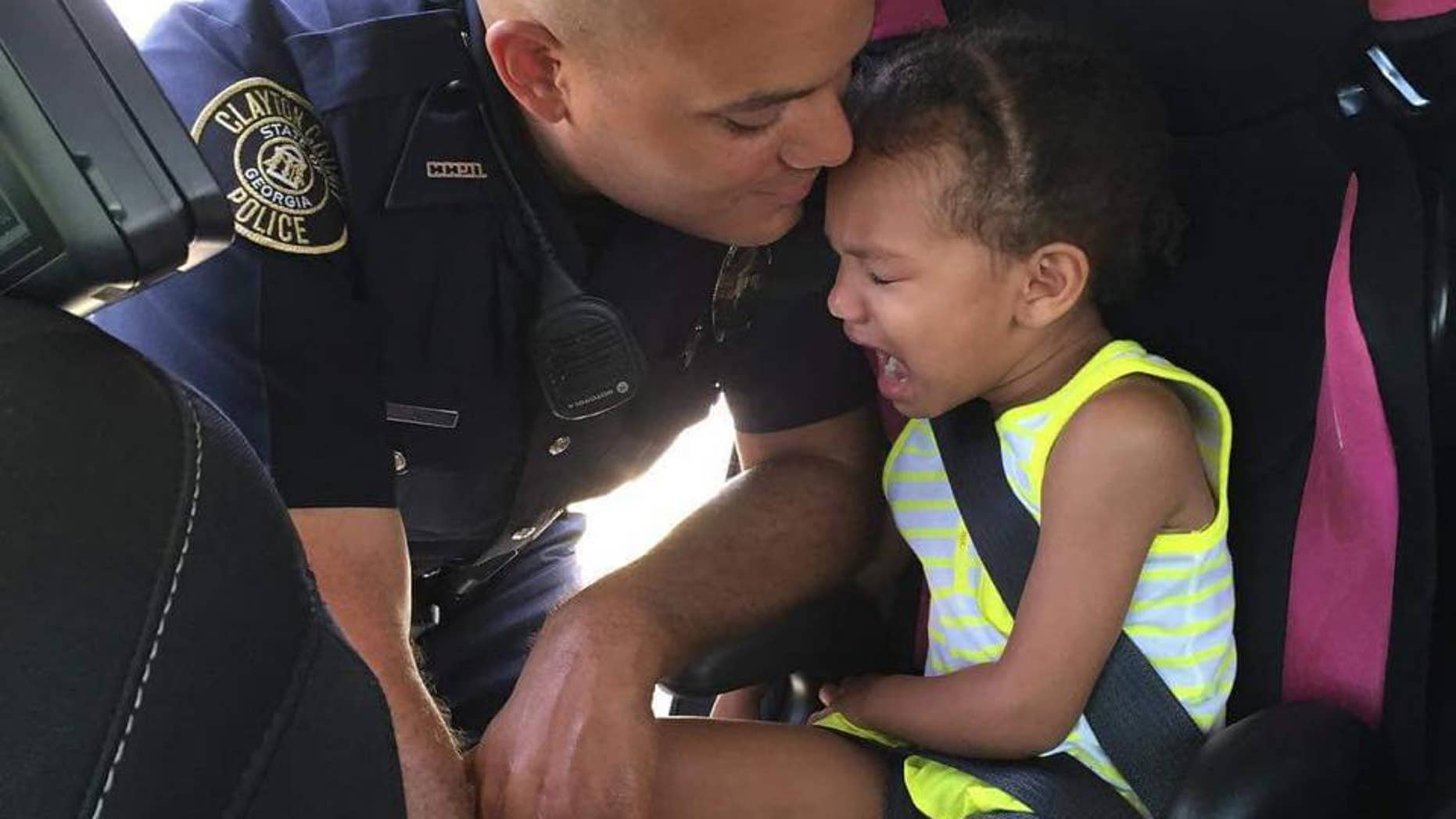 A touching photo shows a goodbye between Officer Rob Fleming and his young daughter.