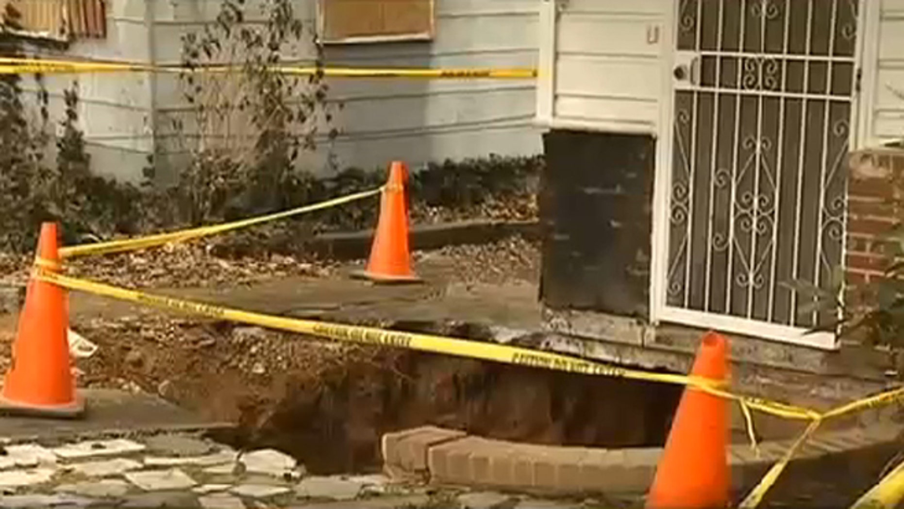 Feb. 5, 2014: A Georgia man rescued his wife after she fell into a sinkhole that opened up in front of their house.