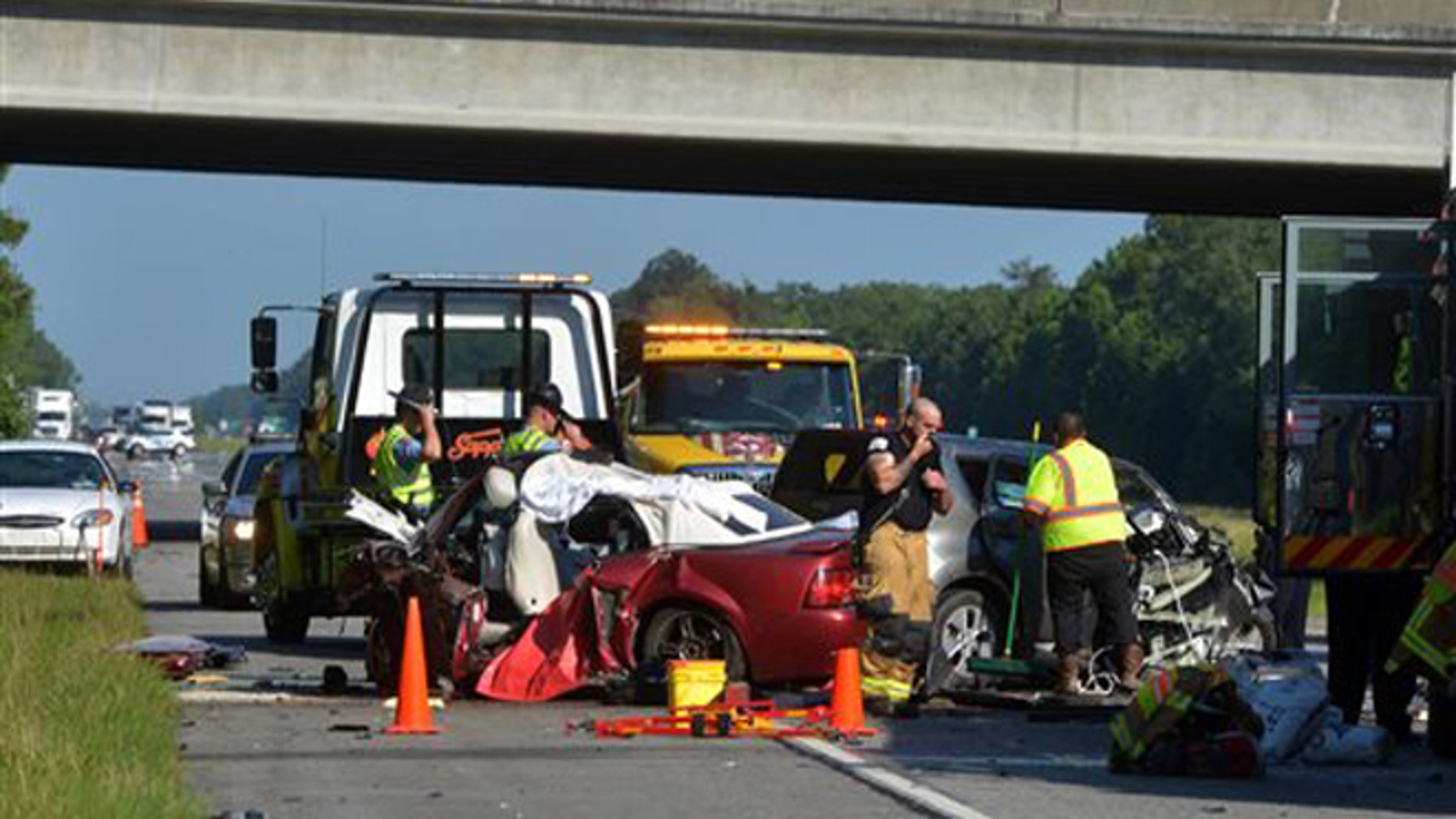Police investigate at the scene of a head-on crash that killed five people early Wednesday, June 22, 2016, on Interstate 16 near exit 155 in Pooler, Ga.