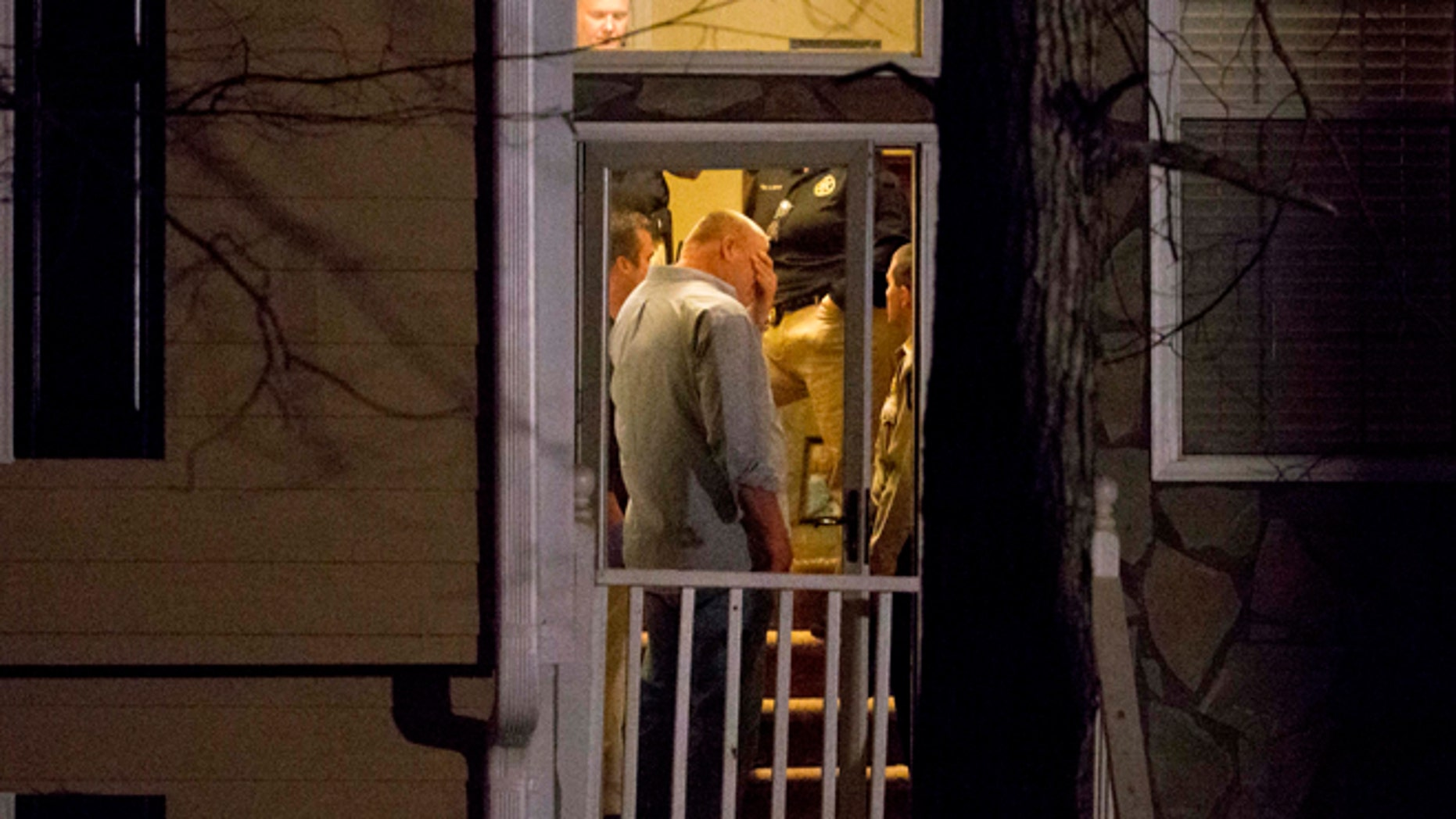 Feb. 7, 2015: Police stand in the doorway of a home while investigating the shooting scene where authorities say five people are dead, including the gunman, in Douglasville, Ga. (AP)
