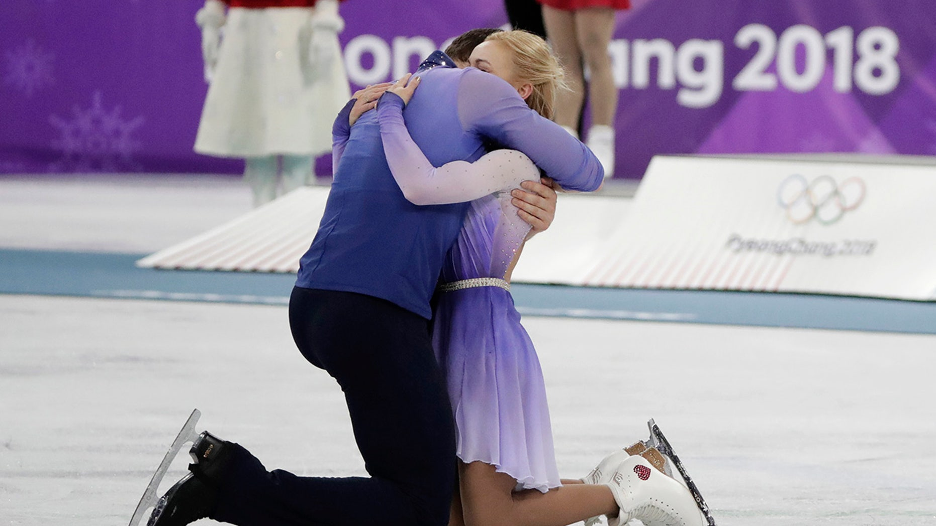 Aljona Savchenko and Bruno Massot of Germany embrace as they celebrate during the venue ceremony after winning the gold medal in the pairs free skate figure skating final in the Gangneung Ice Arena at the 2018 Winter Olympics in Gangneung, South Korea, Thursday, Feb. 15, 2018.