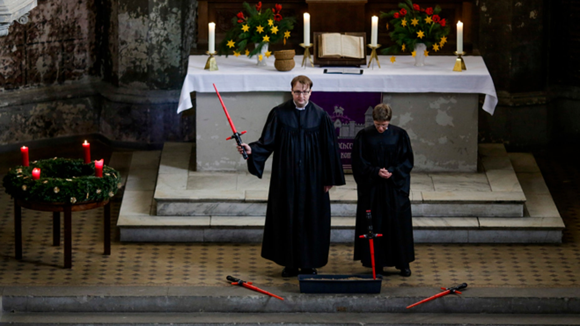December 20, 2015. Vicars Lucas Ludewig, left, and Ulrike Garve, right, celebrate a Star Wars themed church service, at the  Zion Church  in Berlin, Germany.