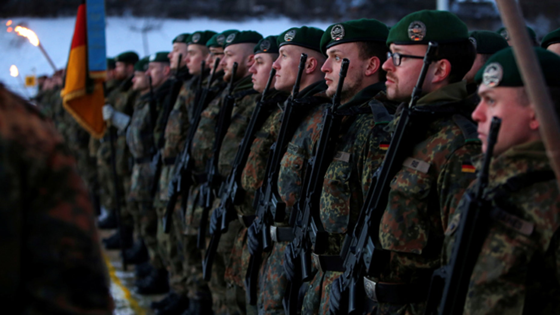 Soldiers of the German armed forces Bundeswehr take part in farewell ceremony for Panzergrenadierbataillon 122, deployment in Lithuania, in Oberviechtach, Germany January 19, 2017.  REUTERS/Michaela Rehle - RTSWFXO