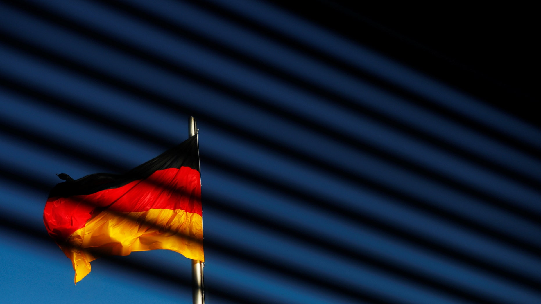 File photo - The German flag is pictured at the Reichstag building  in Berlin, Germany, Nov. 7, 2017. (REUTERS/Hannibal Hanschke)