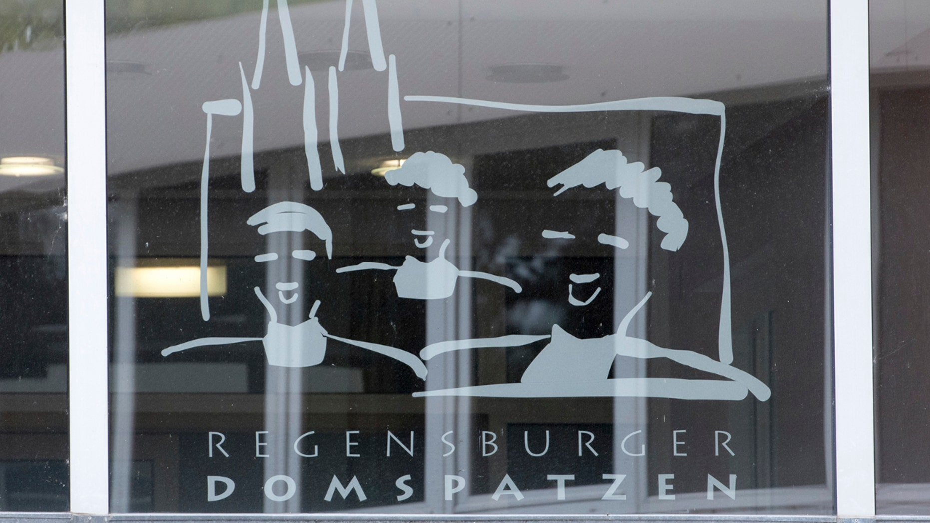 This Oct. 12, 2016 file photo shows the logo of the Regensburger Domspatzen choir at a window of the high school in Regensburg.