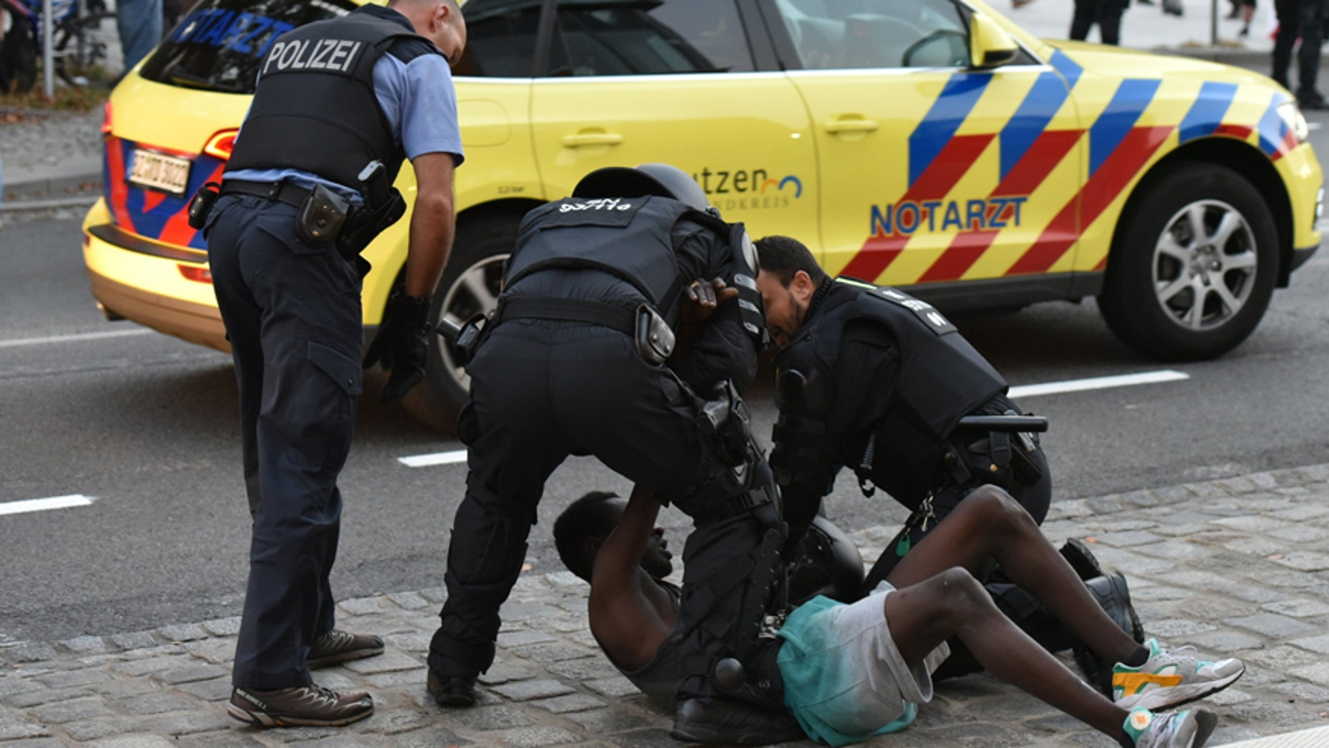 Sept. 10, 2016: Police officers take a man into custody during a gathering on a square at the Kornmarkt in Bautzen, Germany.