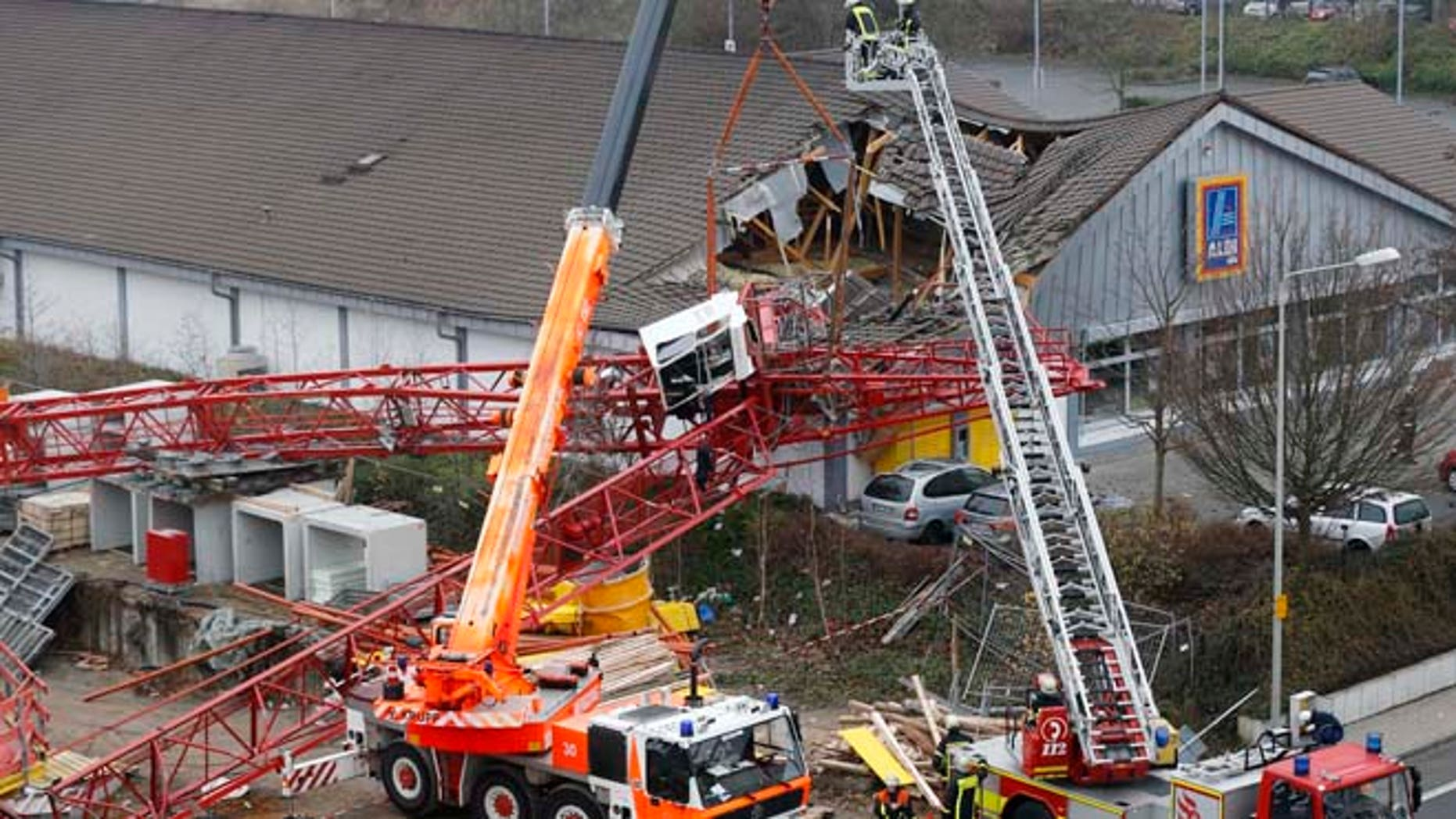 Dec. 11, 2013: A crane from a construction site has crashed into the roof of a supermarket in Bad Homburg, Germany.