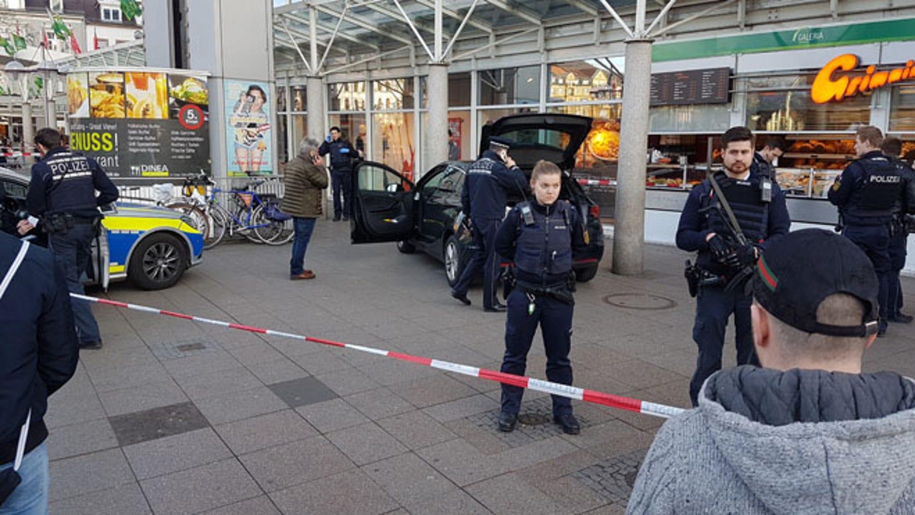 Police guard a car that crashed into pedestrians in Heidelberg, Germany, Saturday.  (Priebe/PR-Video/dpa via AP)