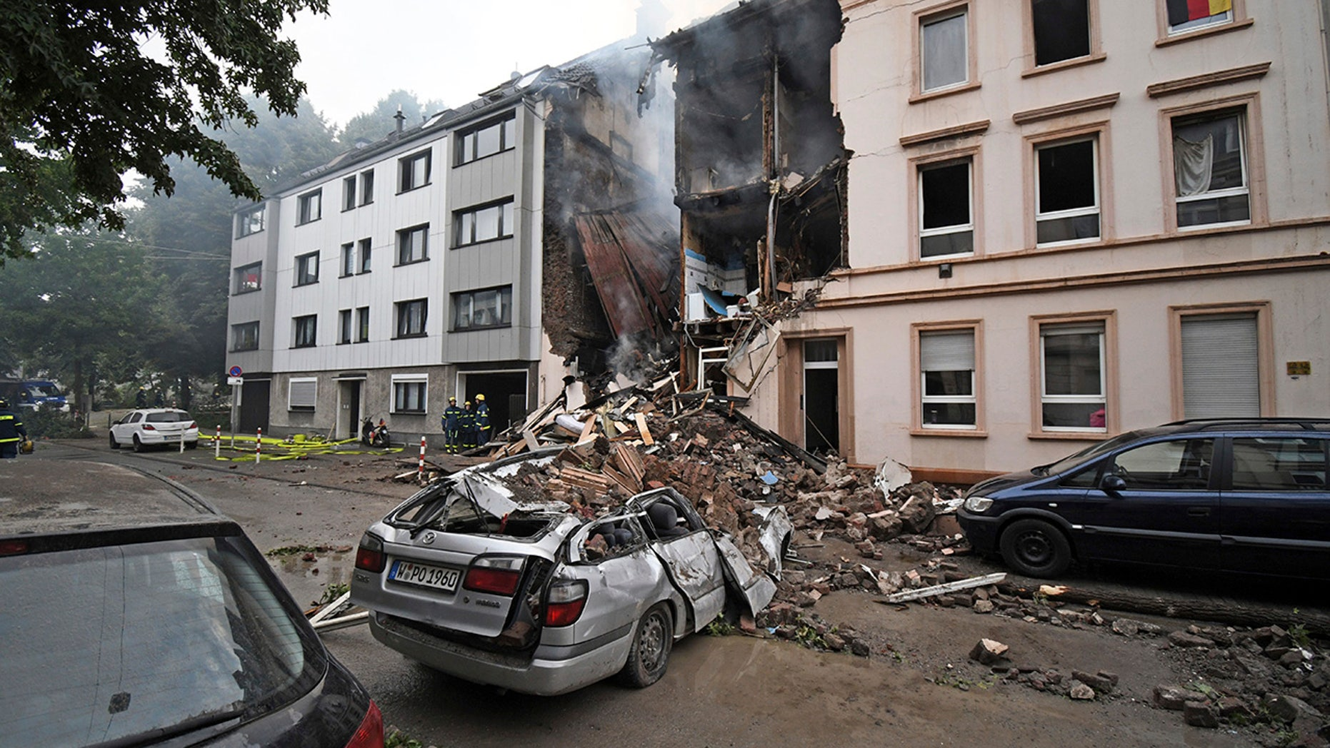 German police say at least 25 people were injured when an explosion destroyed a car and a house in Wuppertal, Germany, June 24, 2018.
