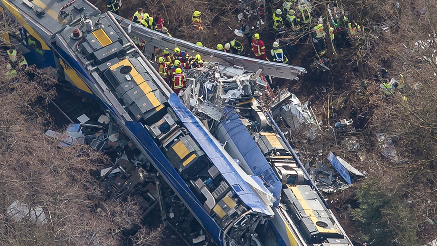 Aerial view of rescue forces working at the site of a train accident near Bad Aibling, Germany, Tuesday, Feb. 9, 2016. Several people were killed when two trains collided head-on. (Peter Kneffel/dpa via AP)