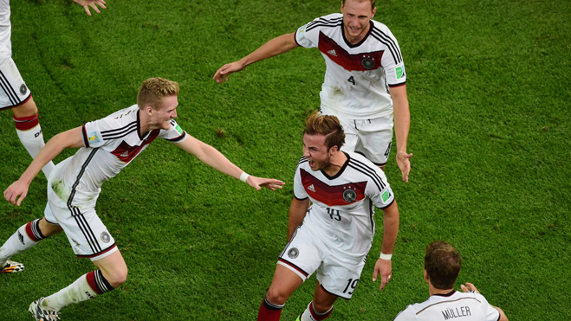 July 13, 2014: Germany's Mario Goetze, center, celebrates scoring his side's first goal during the World Cup final soccer match between Germany and Argentina at the Maracana Stadium in Rio de Janeiro, Brazil/