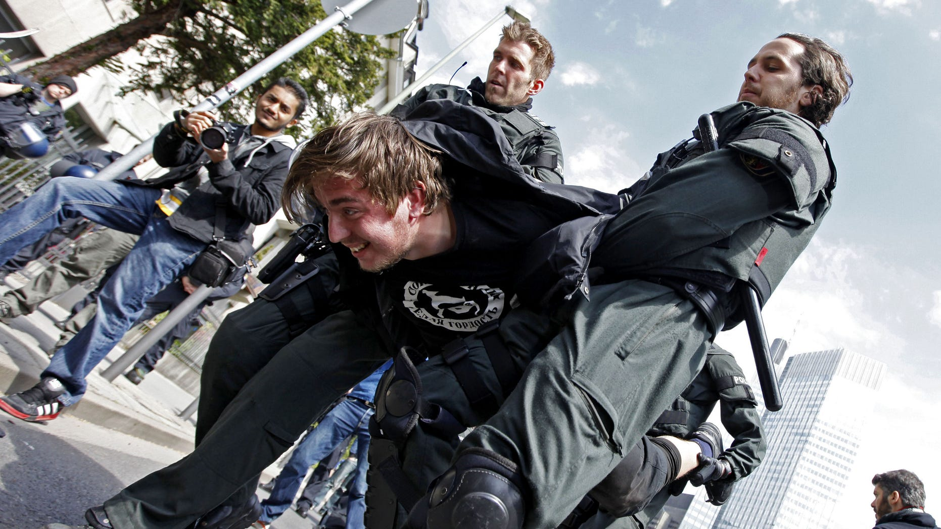 May 18, 2012: Police carry a protester away, after demonstrators had blocked a street  in Frankfurt, central Germany. Police in Germany have temporarily detained some 400 demonstrators during largely peaceful protests by Occupy activists.