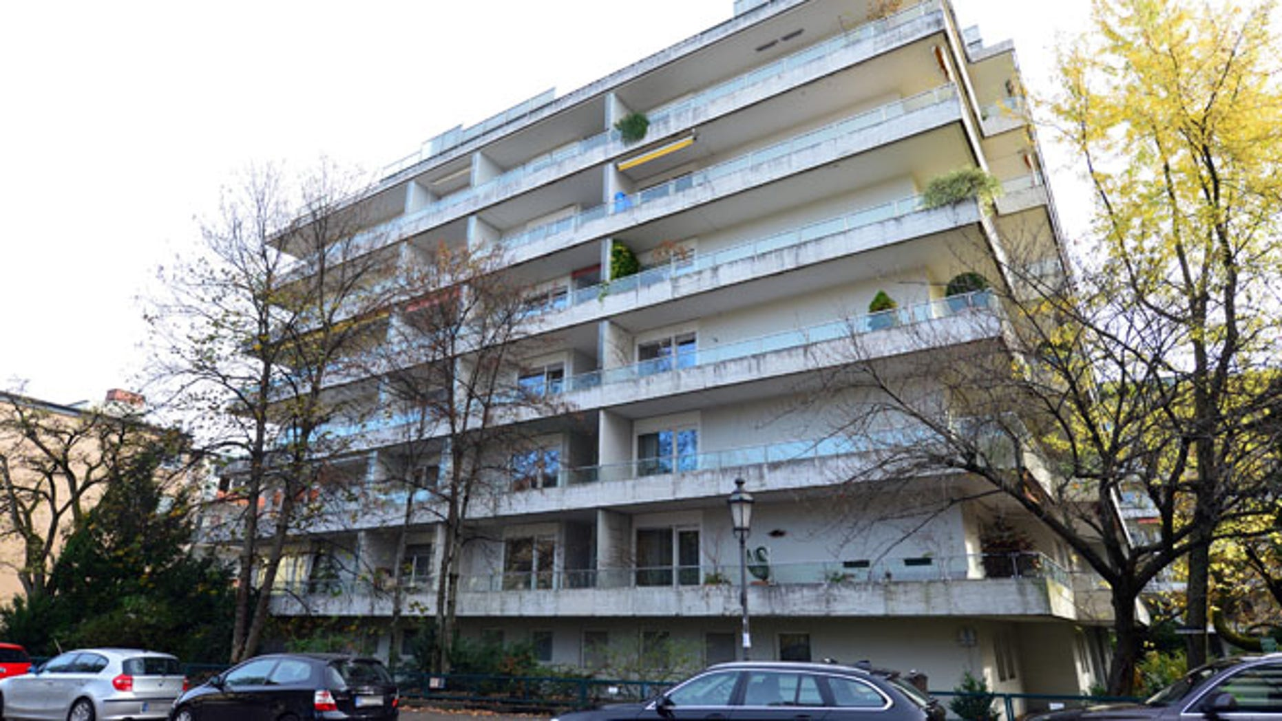 Nov. 4, 2013: In this file photo cars are parked outside the apartment building in Munich, Germany, where more than 1,400 artworks were found in the apartment of collector Cornelius Gurlitt.
