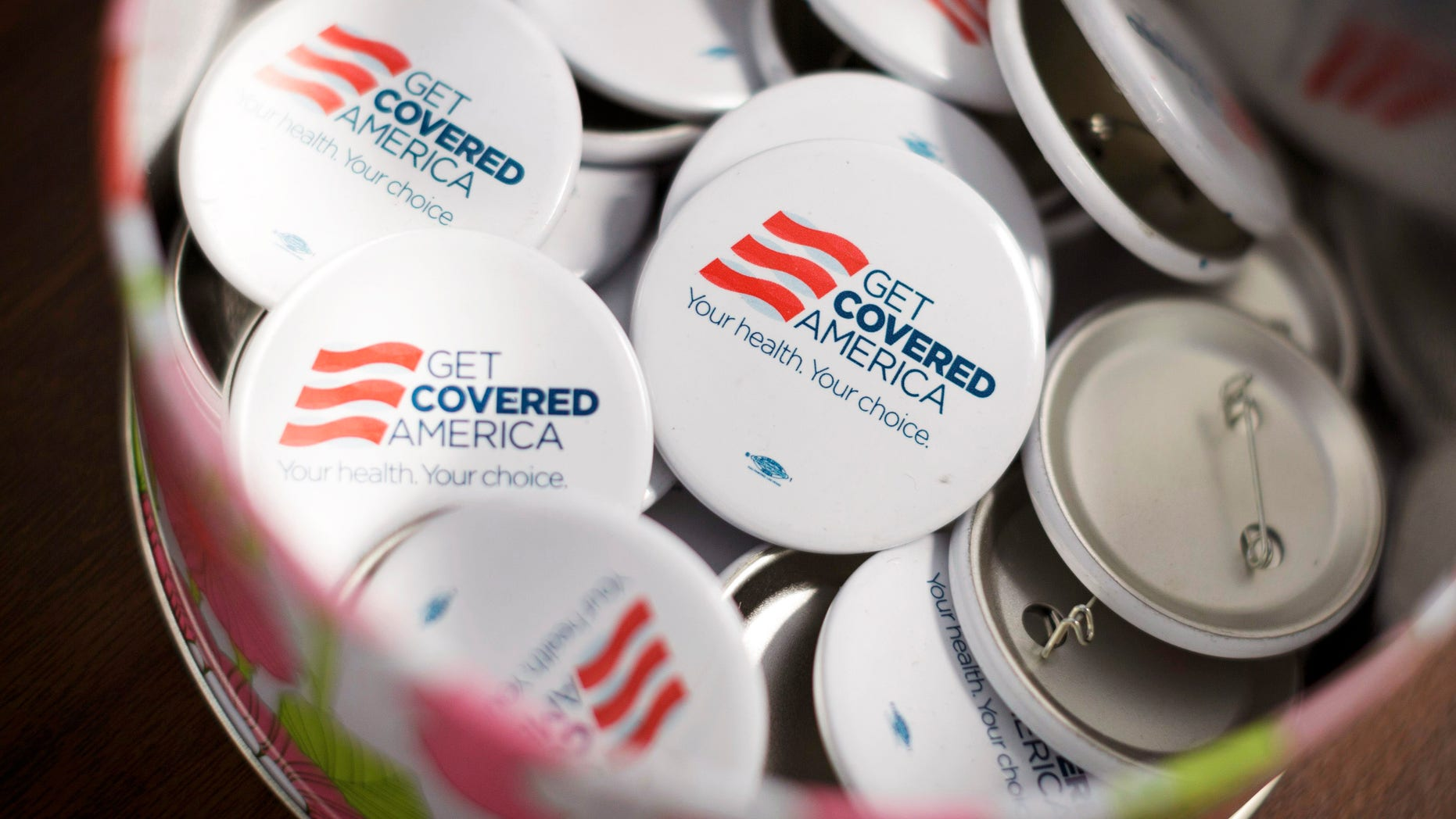 Sept. 7, 2013: Get Covered America buttons are seen during a training session in Chicago, Illinois  before volunteers canvas a Chicago neighborhood to talk with residents about the Affordable Care Act .