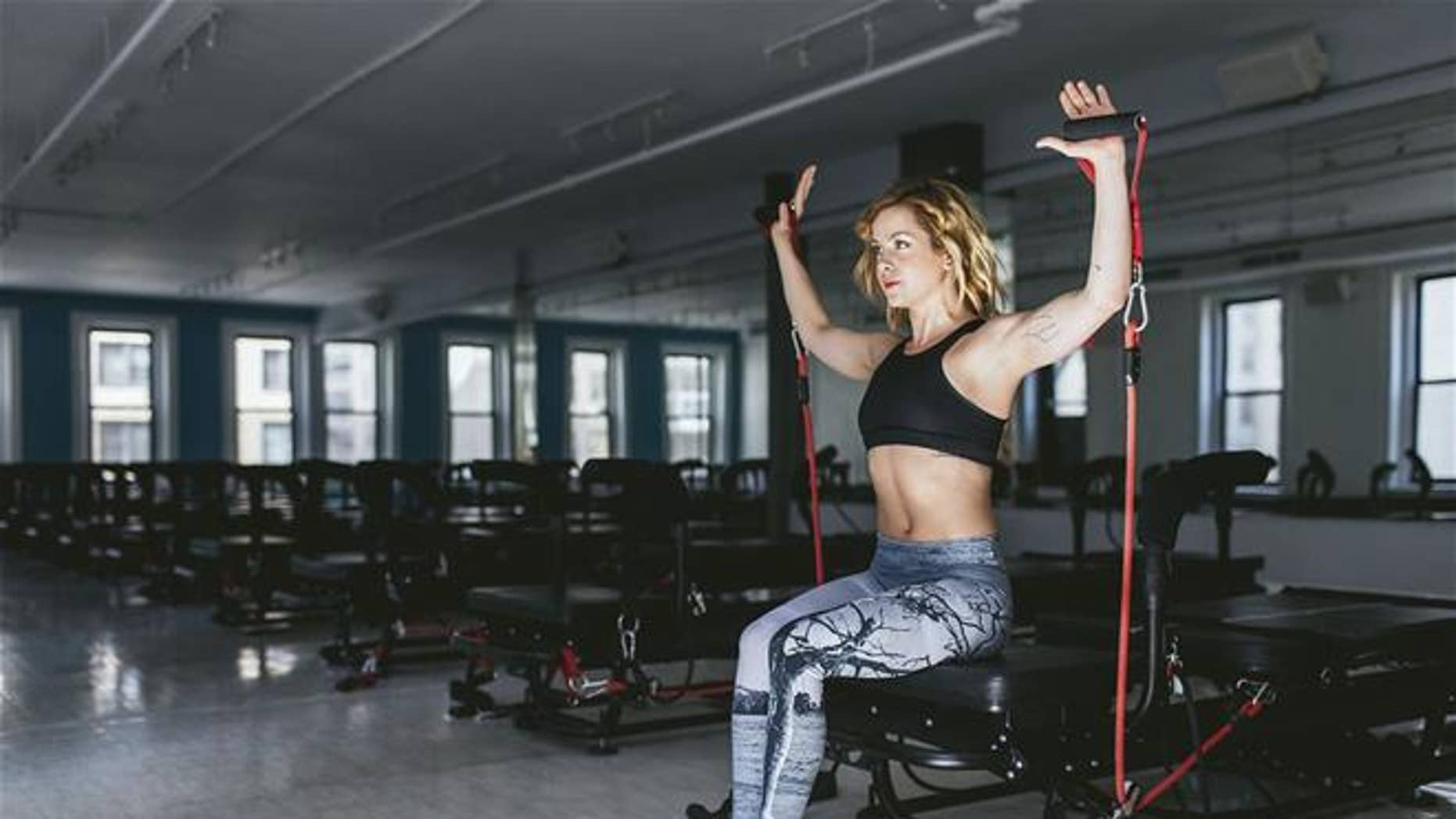 A fitness trainer is shown at NYC's SLT studios.