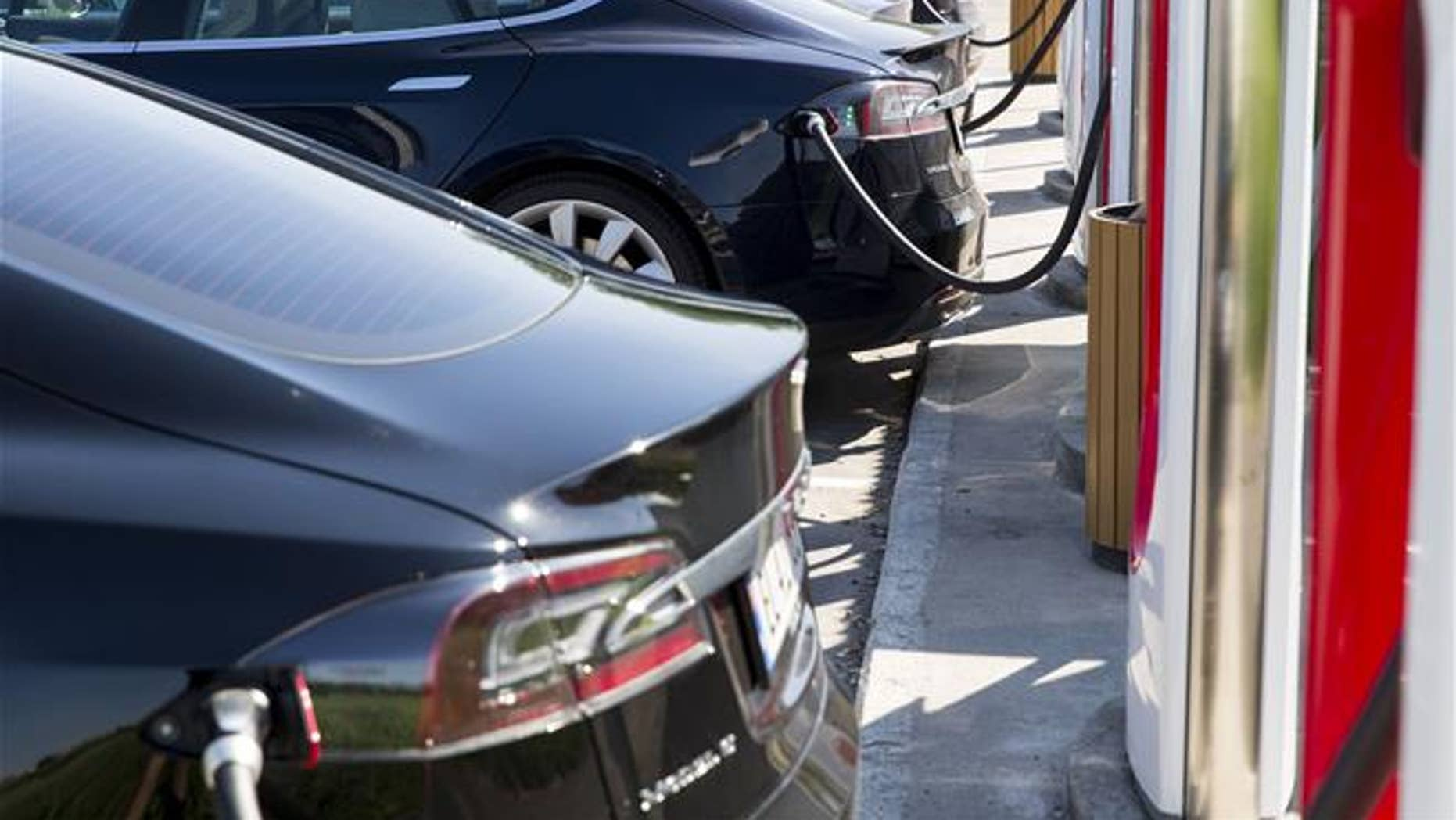 In this June 4, 2016 file photo, electric Tesla cars park at a supercharger facility in Sarpsborg, Norway (Tore Meek / NTB scanpix via AP, File).