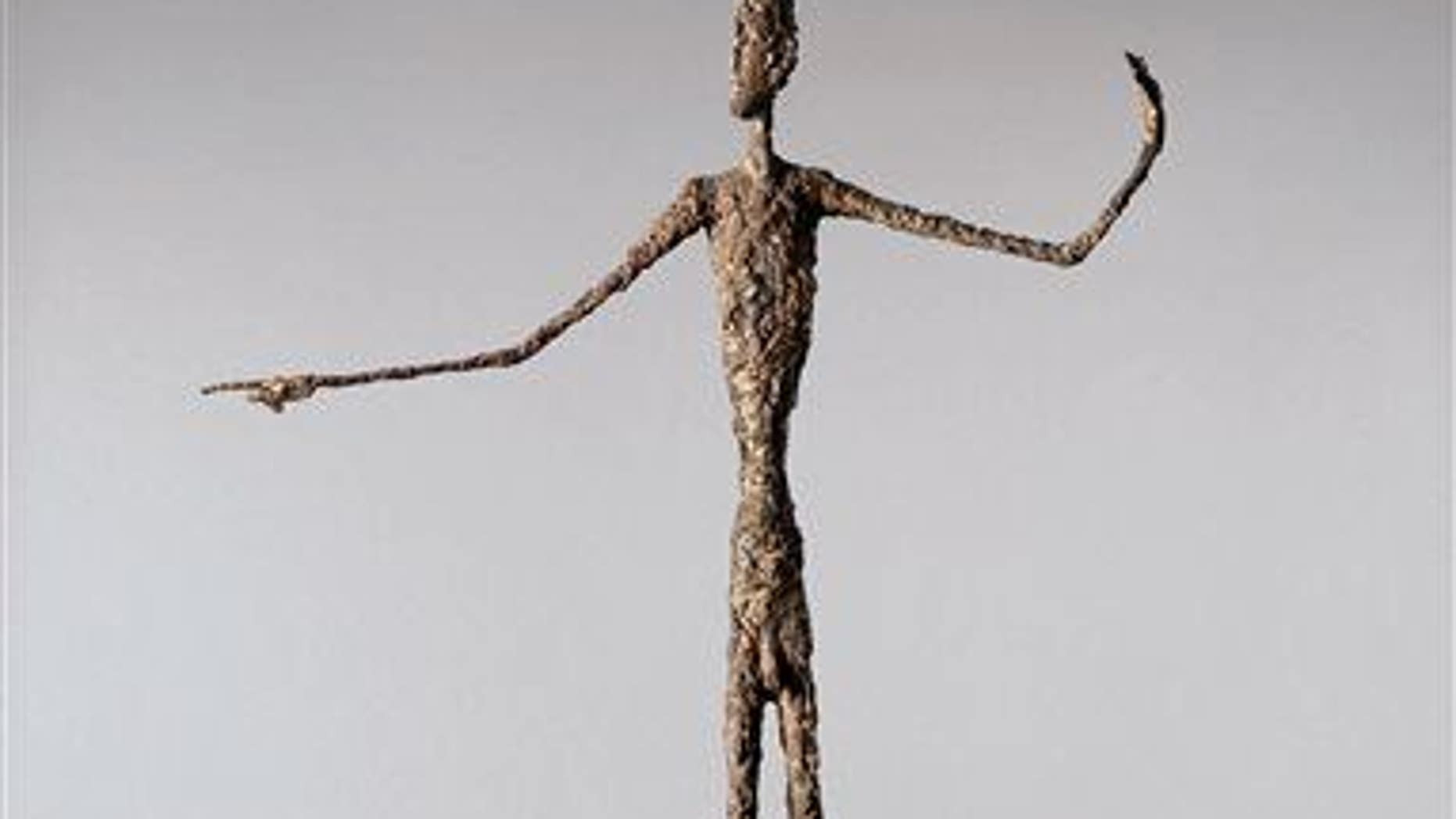 """A file photo of Alberto Giacometti's life-size """"Pointing Man."""""""