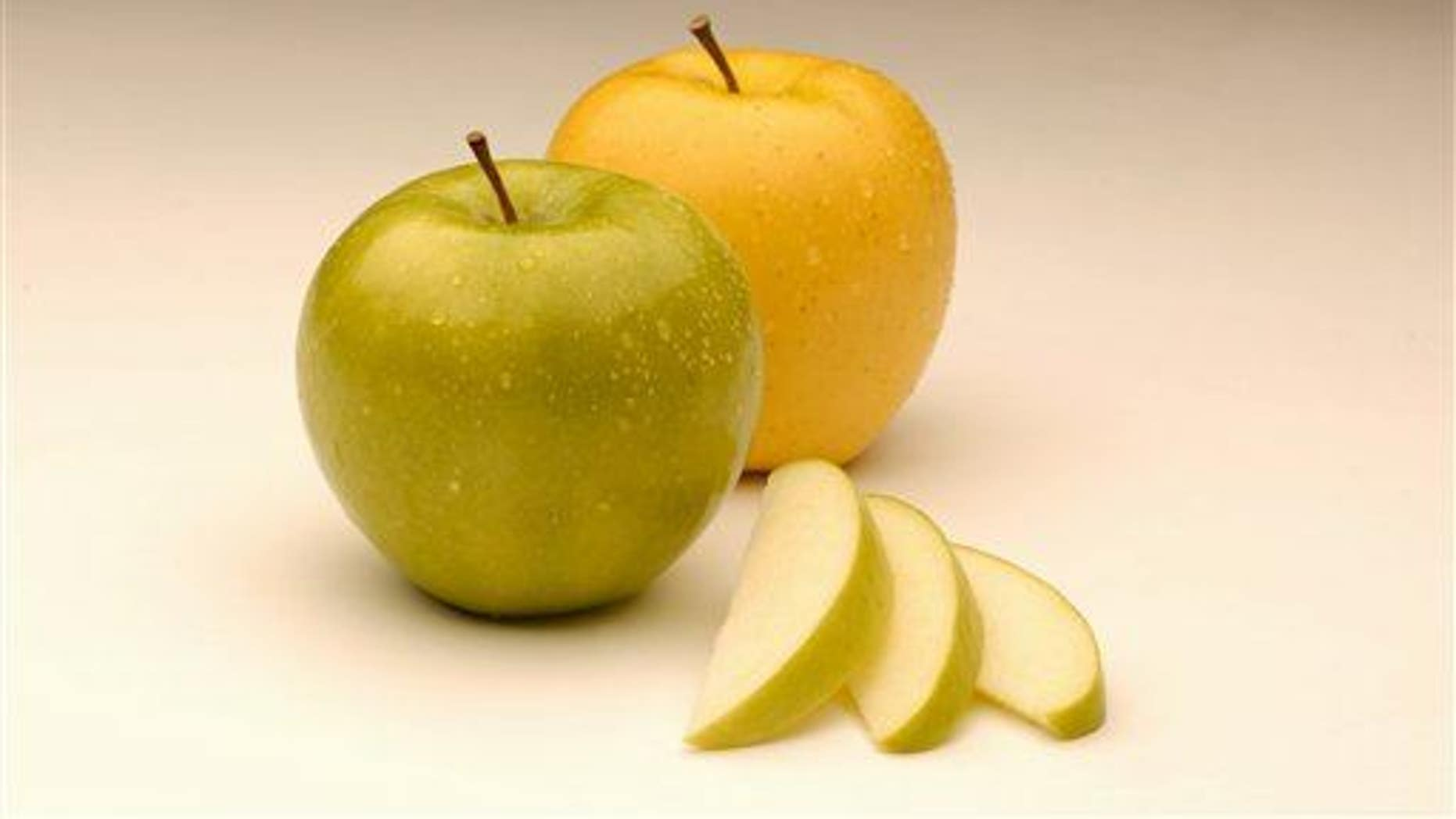 An Arctic Granny apple, left, from Canada's Okanagan Specialty Fruits is seen with an Arctic Golden variety, right.