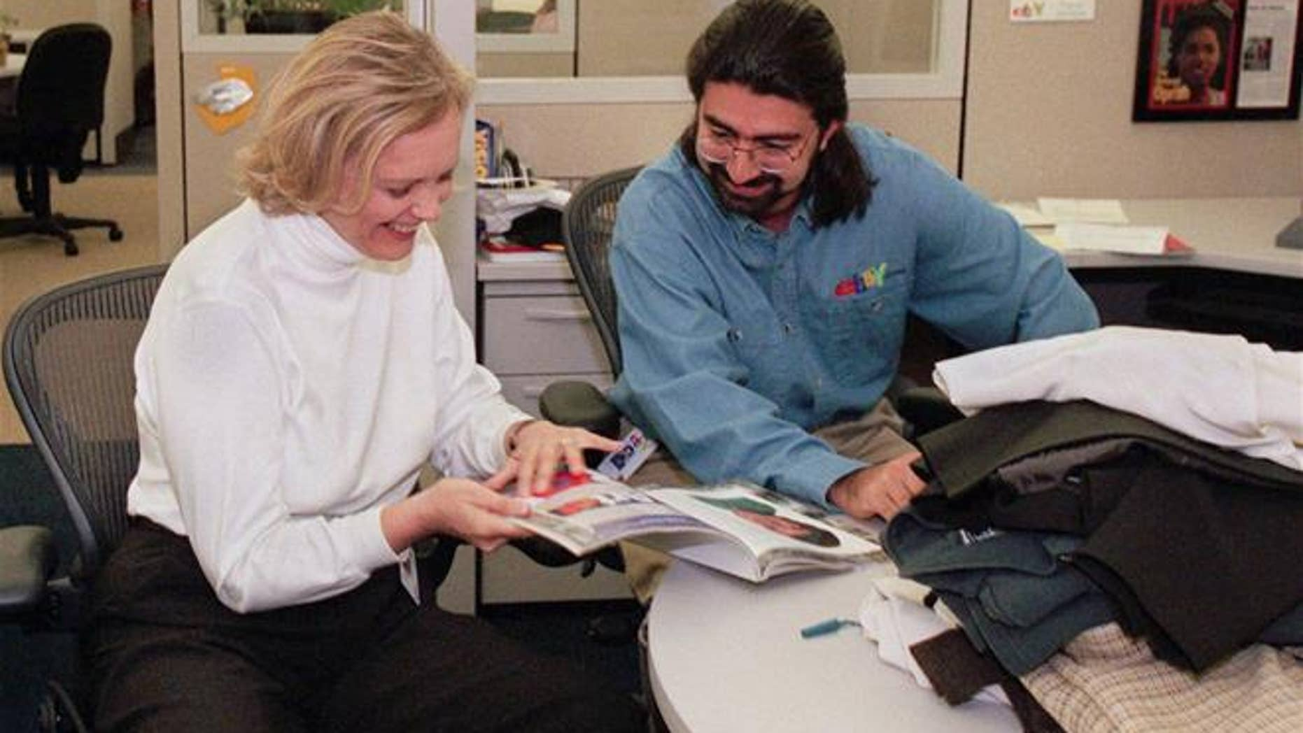 A 1999 file photo of eBay CEO Meg Whitman and founder Pierre Omidyar. (AP Photo/Randi Lynn Beach, File)